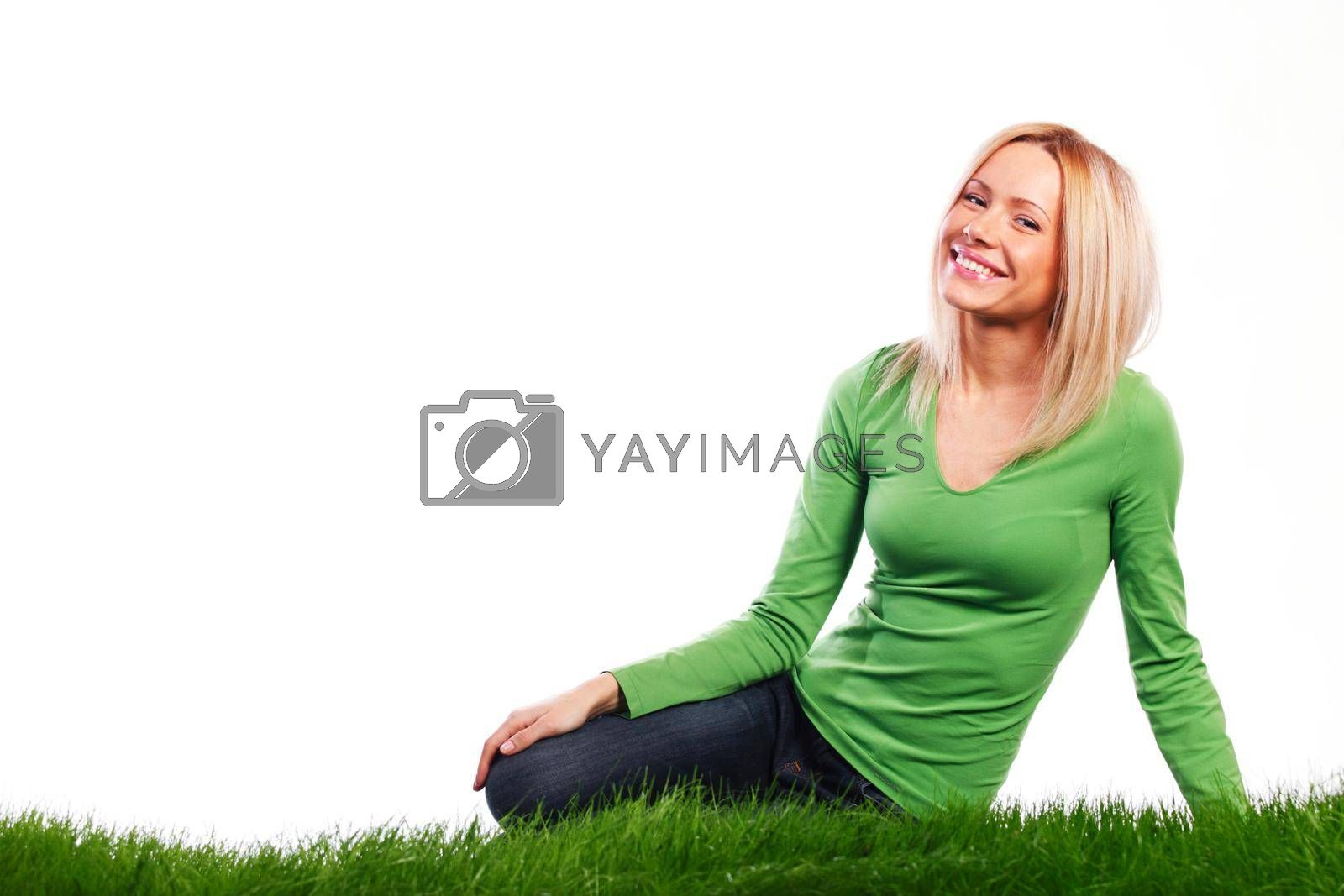 Royalty free image of Young woman sitting on grass by Yellowj