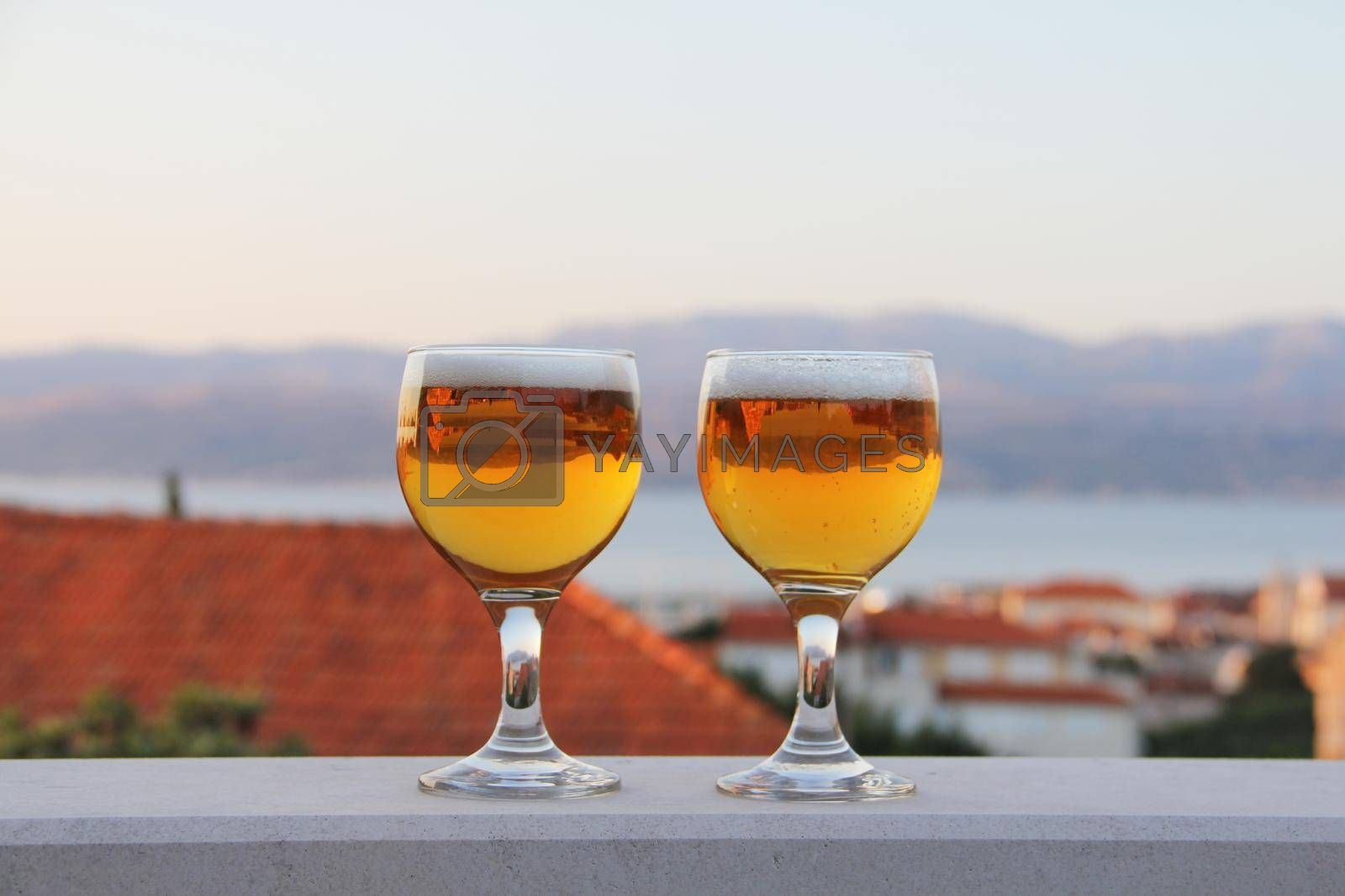 Royalty free image of Two glasses of beer by destillat