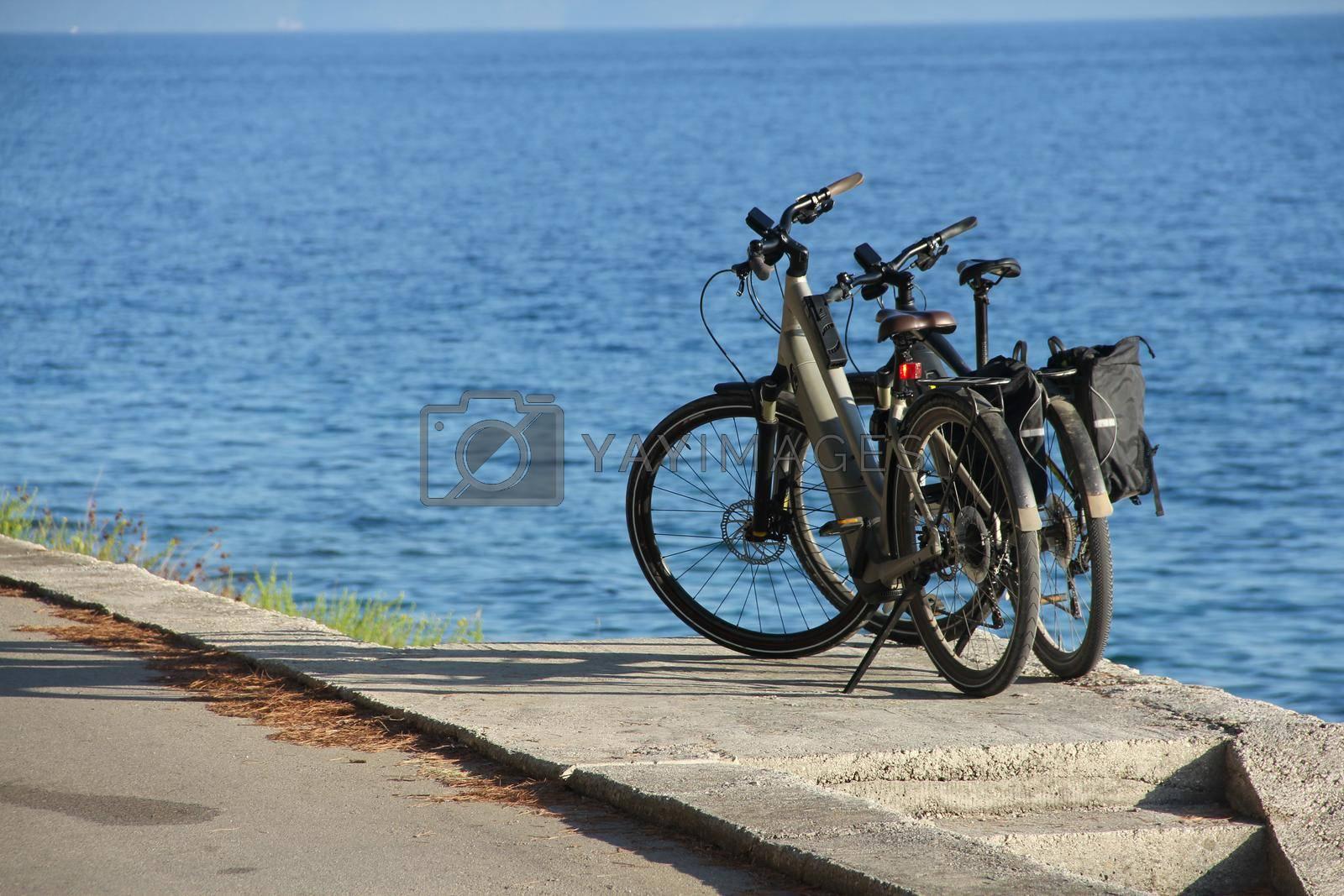 Royalty free image of Two bike near the sea by destillat
