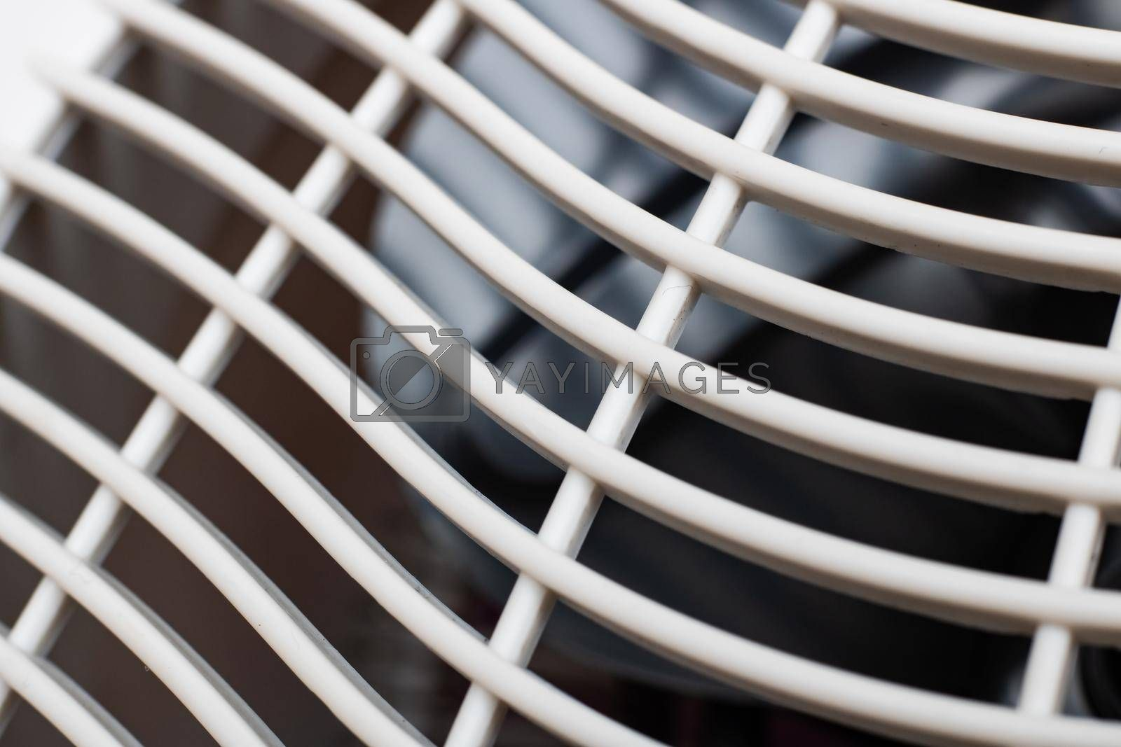 White plastic grill on the fan close up, macro photo