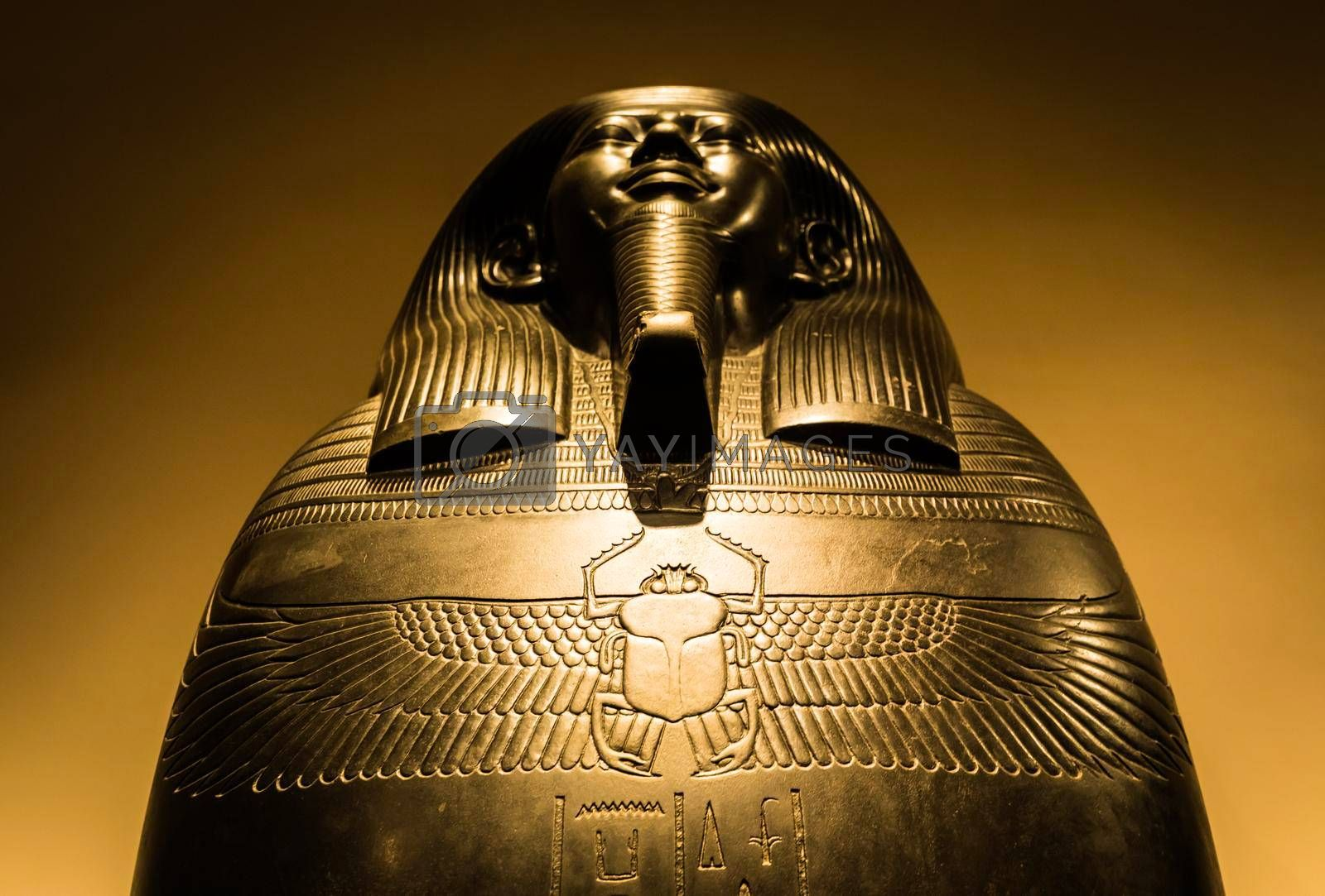 Royalty free image of Egyptian sarchopagus with carved surface and hieroglyphic by Perseomedusa