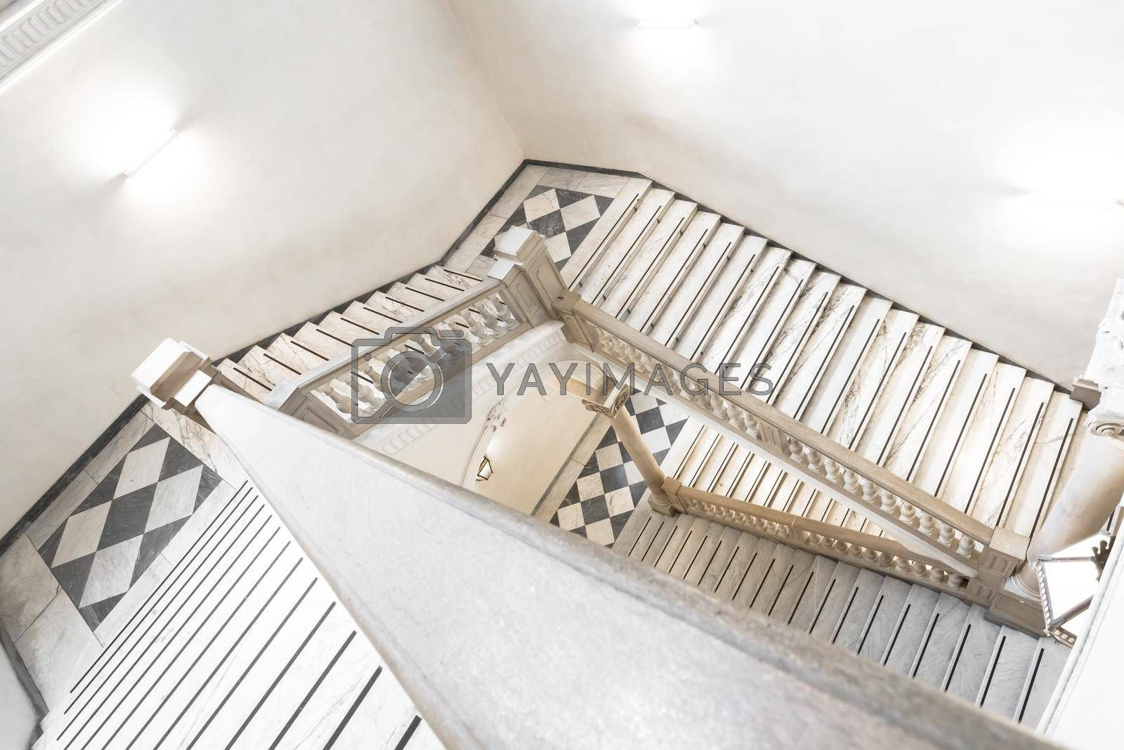 Royalty free image of Luxury staircase made of marble in an antique Italian palace by Perseomedusa