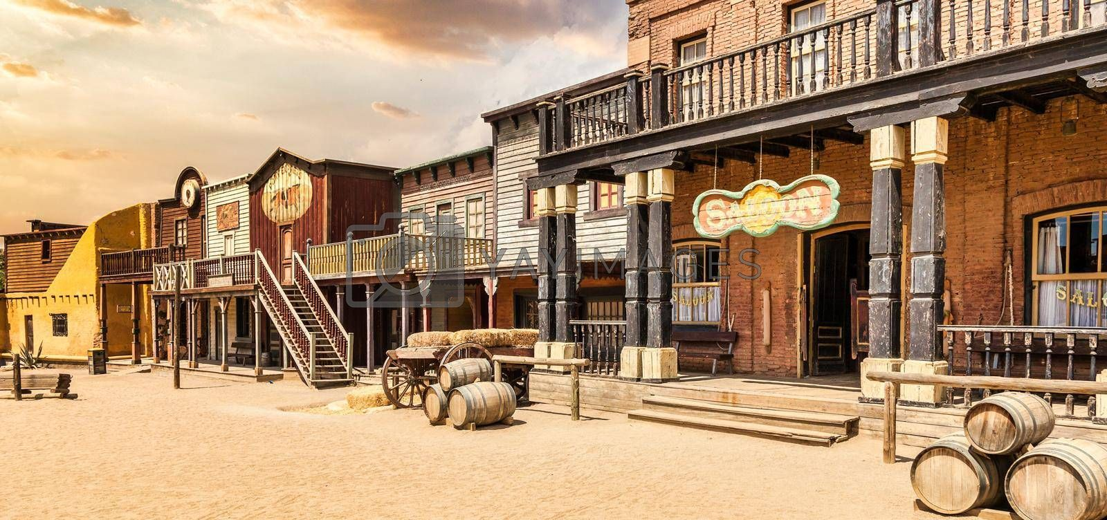 Royalty free image of Vintage Far West town with saloon. Old wooden architecture in Wild West. by Perseomedusa