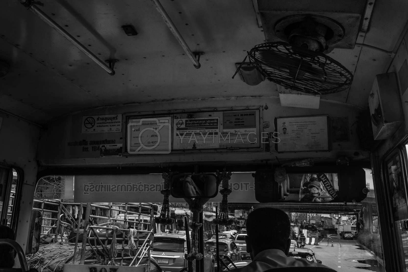 bangkok,Thailand - jun 29, 2019 : The bus driver in a old bus on the roads of bangkok, Black and white.
