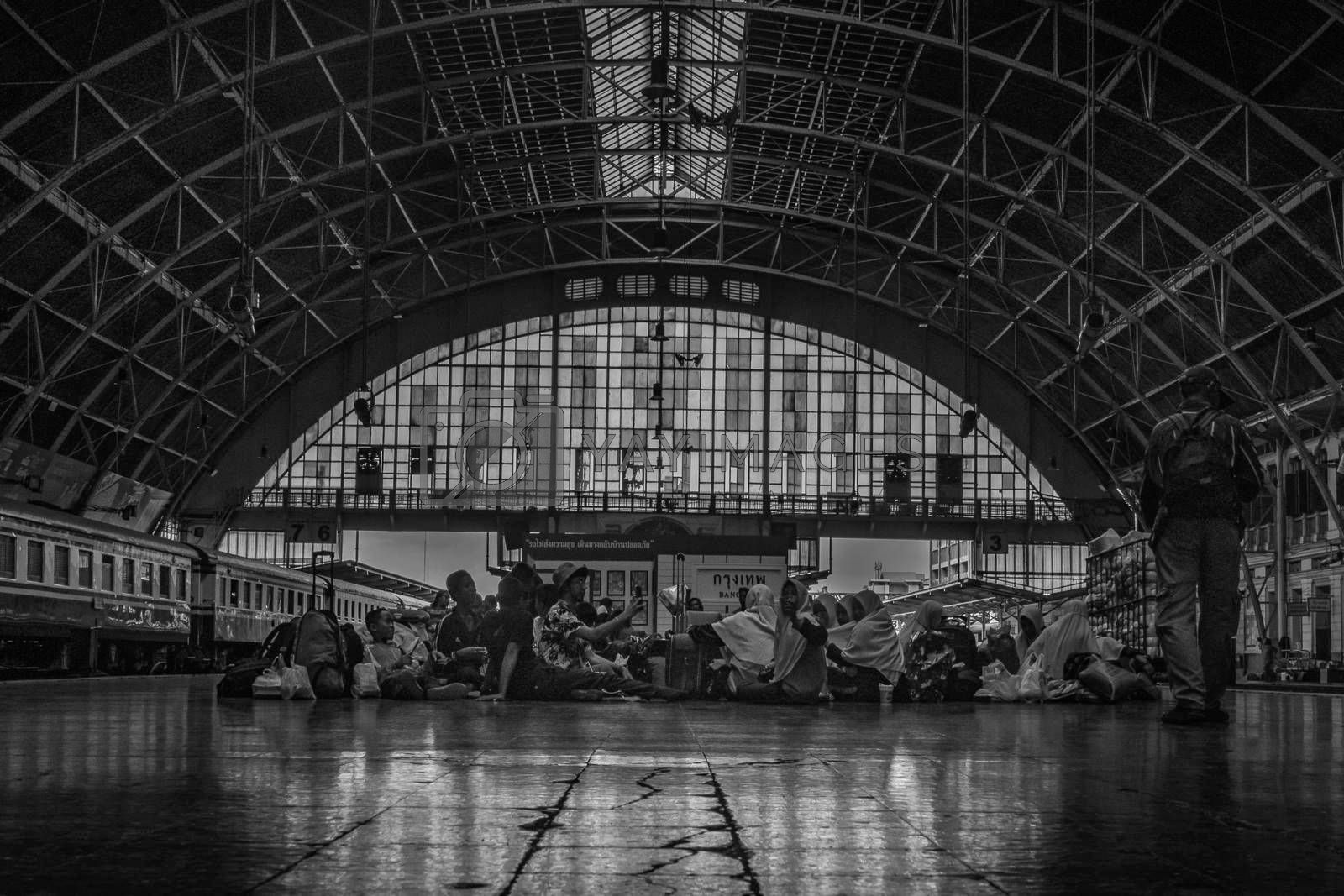 Bangkok, thailand - jun 29, 2019 : Peoples who sit and wait to return to their homeland. Bangkok Railway Station or Hua Lamphong Station is the main railway station in Bangkok, Blackand white.