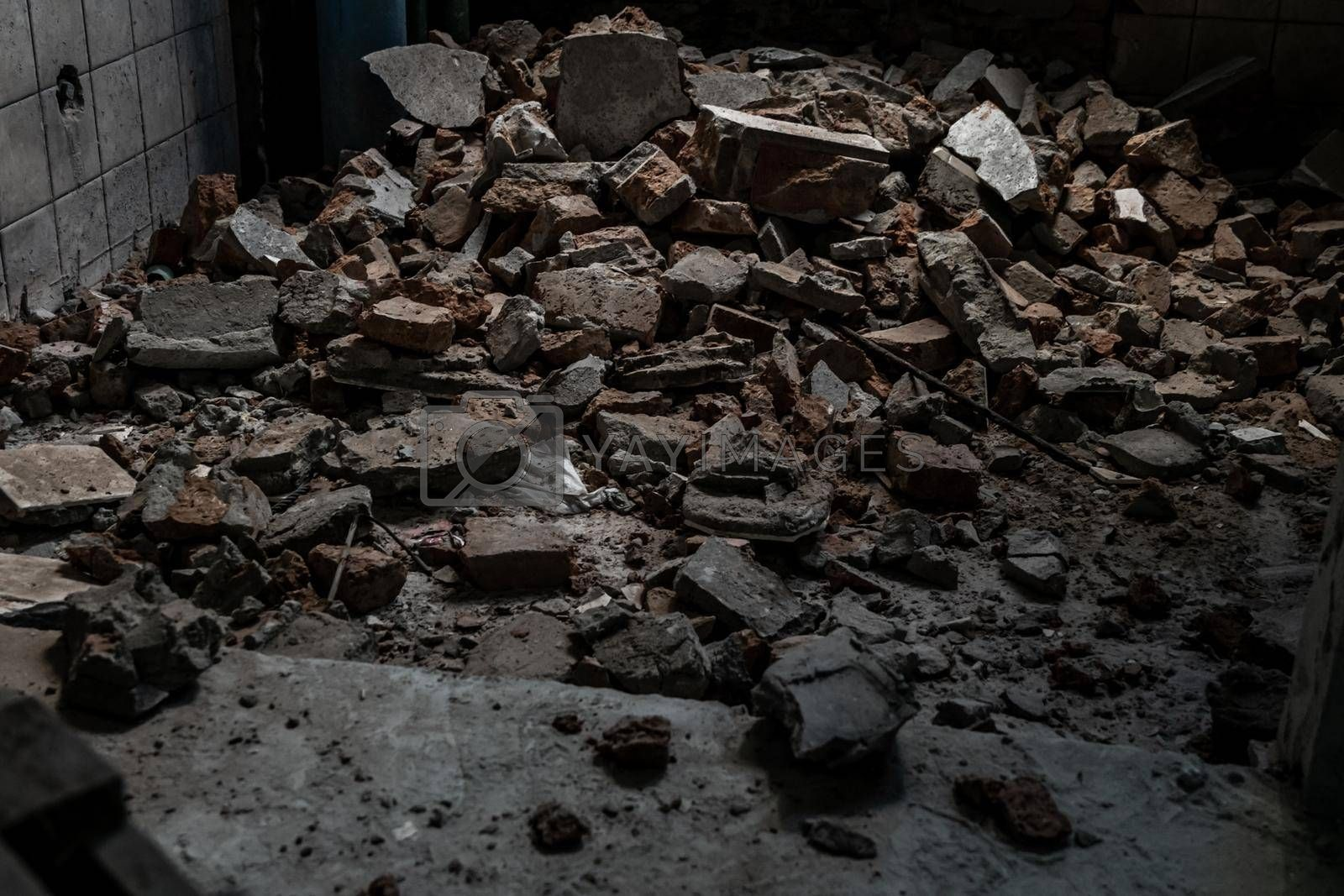 The rubble, A pile of smashed cement stacked together of Deteriorated abandoned old building, Destroyed building, Selective focus.