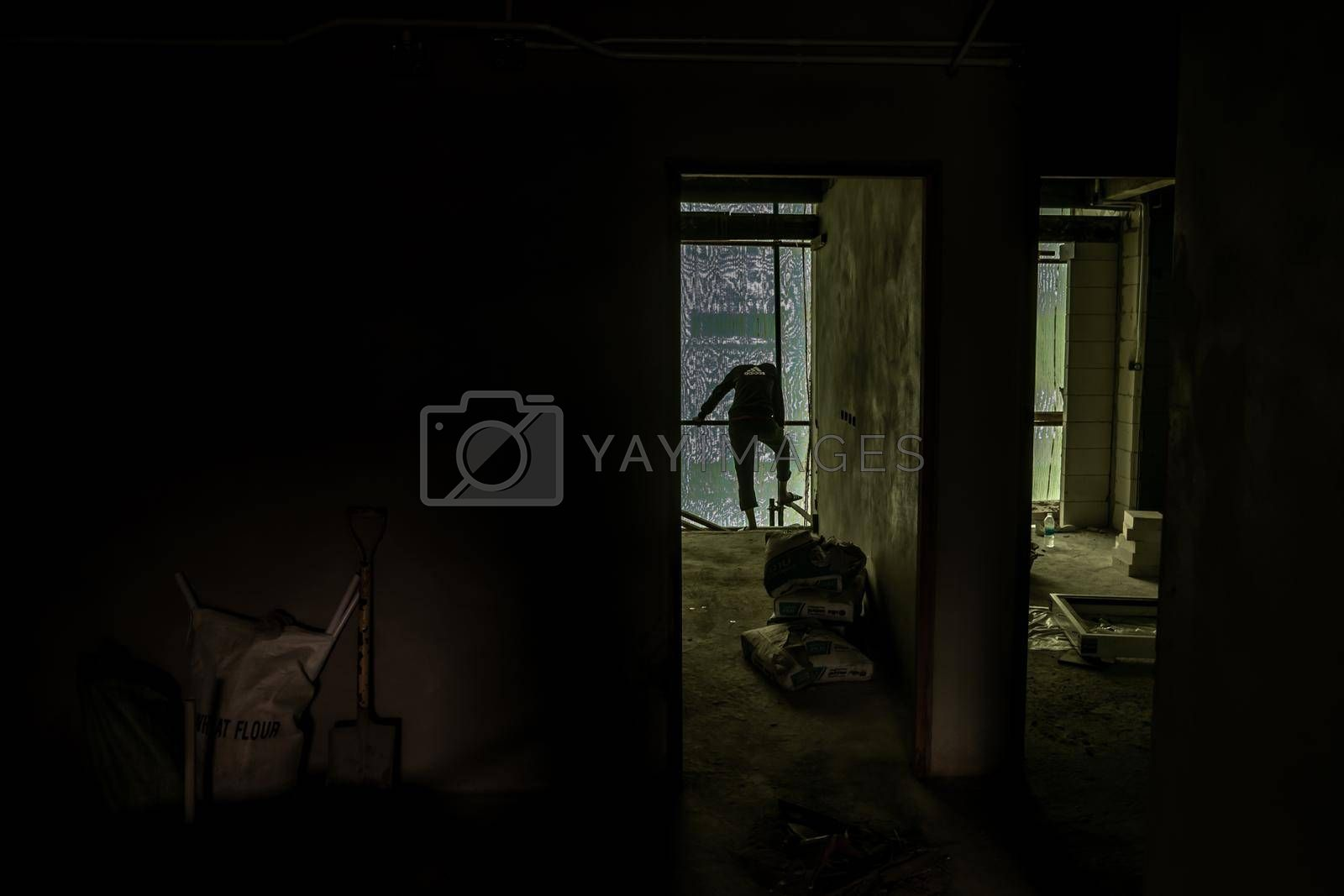 Bangkok, Thailand - Dec 7, 2019 : Worker are plastering on the wall building interior, commercial building.