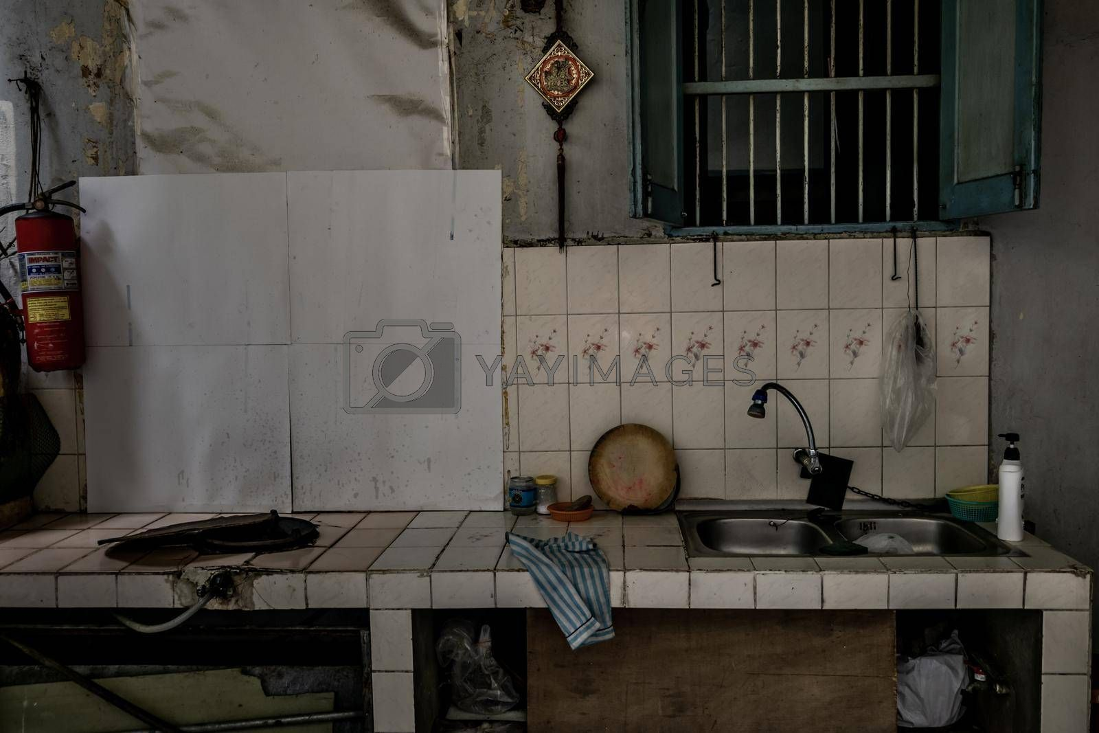 Bangkok, Thailand - Dec 7, 2019 : Ancient tiled countertops with gas stove and kitchen sink In front of the old house.