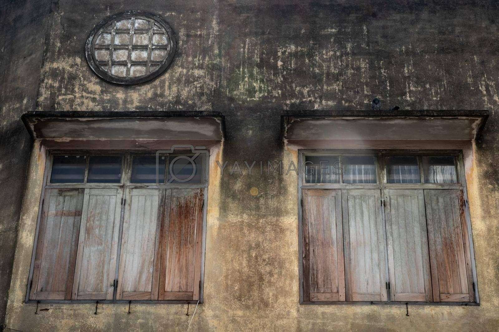 Bangkok, Thailand - Dec 12, 2019 : Two wood vintage window on the old wall, Chinese house style.
