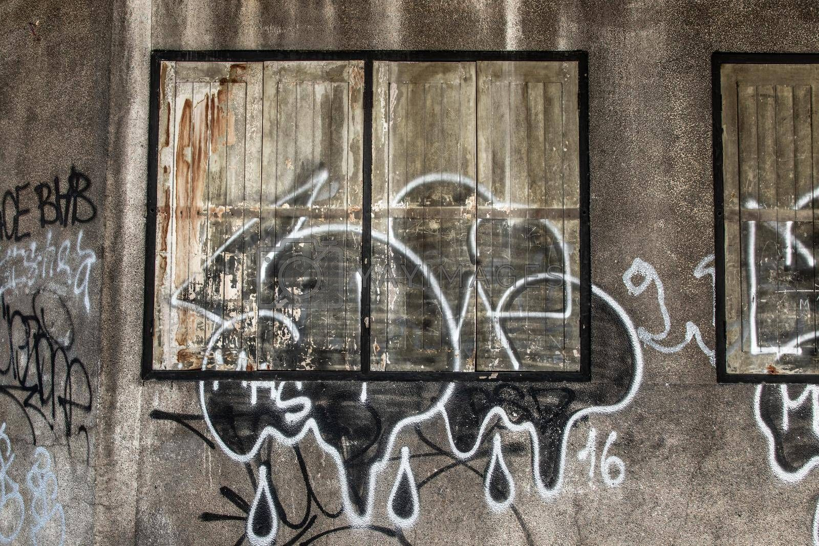 Bangkok, Thailand - Dec 12, 2019 : Wood vintage window on the old wall and graffiti painting.