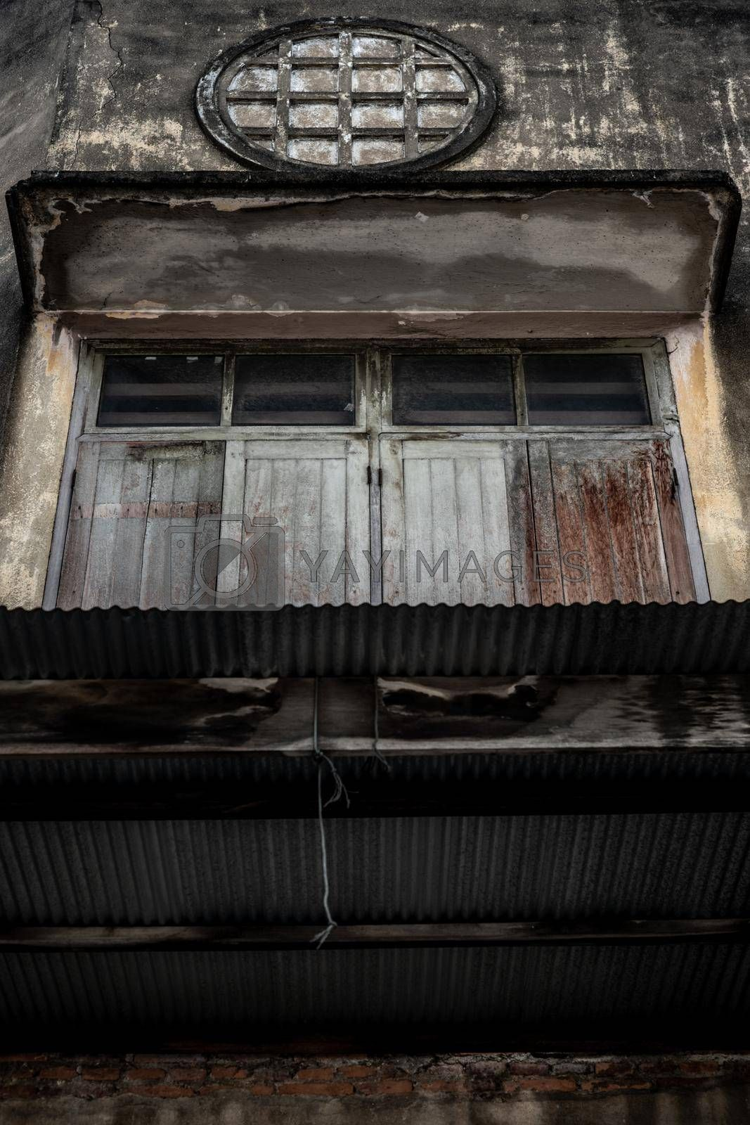 Bangkok, Thailand - Dec 12, 2019 : Wood vintage window on the old wall, Chinese house style.