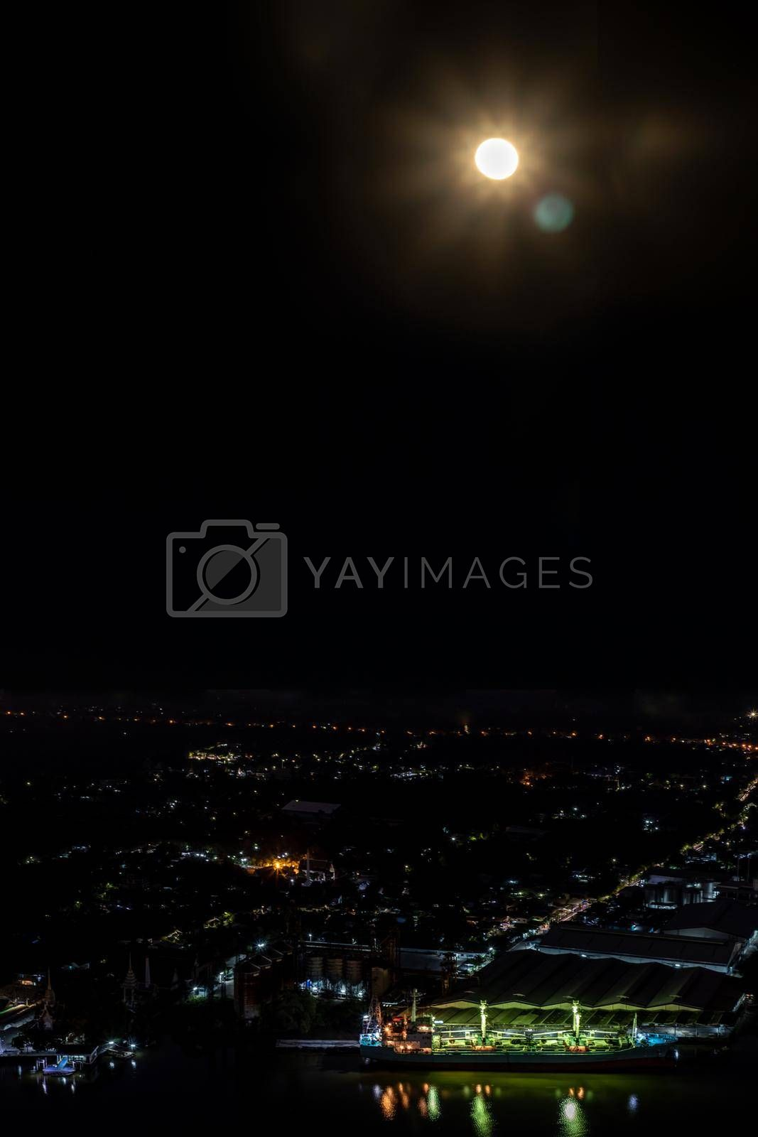 Bangkok, Thailand - Dec 7, 2019 : Full moon In the dark sky and The Beauty Of The Chao Phraya River, Cityscape of Chao Phraya River (Bang Kachao).