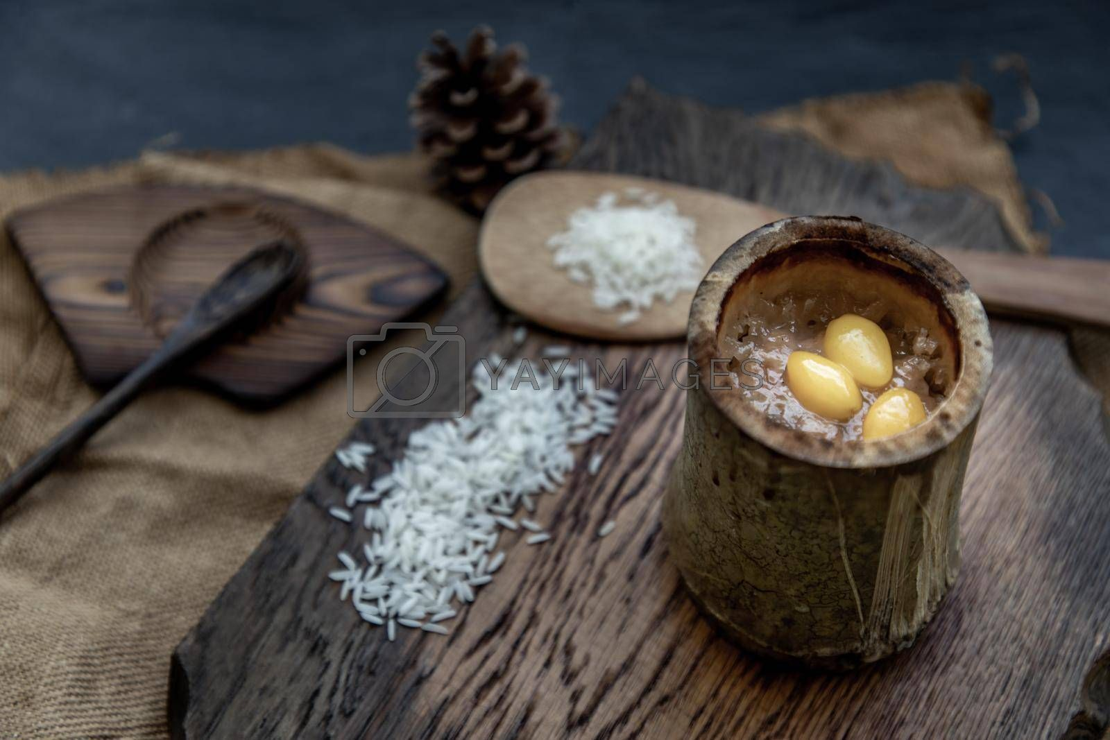 Sticky Rice Cooked with Coconut milk (Khao lam) or Glutinous rice roasted in bamboo joints on wooden, Thai dessert concept, Oblique view from the top.