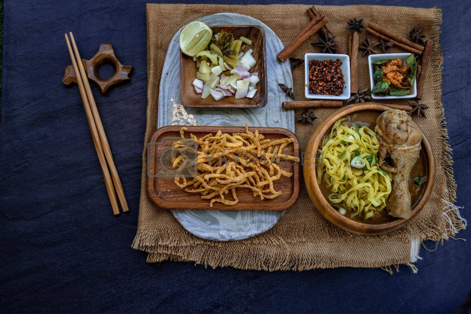 Northern Style Curried Noodle Soup with coconut milk (Khao soi), Traditional of Northern Thai cuisine, Top view.