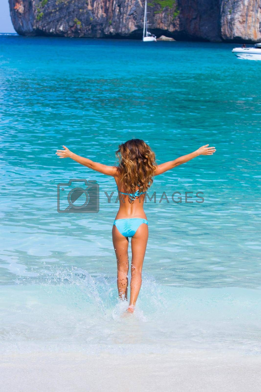 Royalty free image of Woman enjoying summer vacation by Yellowj