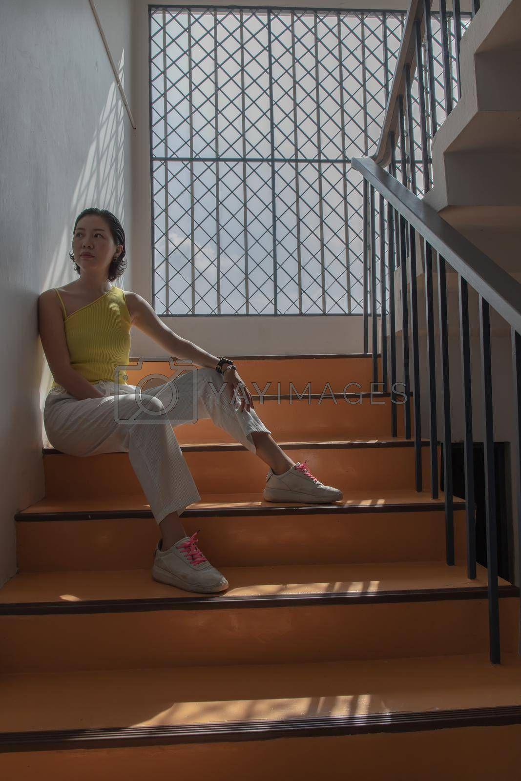 Young asian woman and short hair posing for take a photo on stairs. Selective focus.