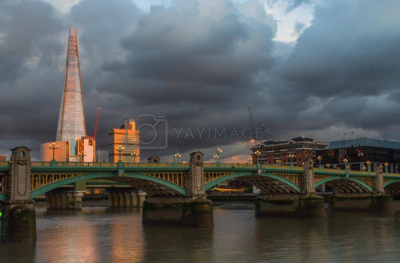 Westminster Bridge and the Shard at sunset and colorful dusk sky.