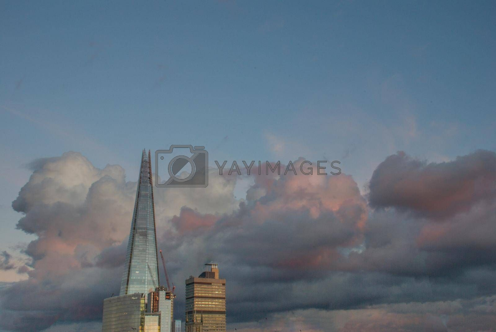 London and Shard, which is the tallest building in the city There is a backdrop of beautiful sky and clouds.