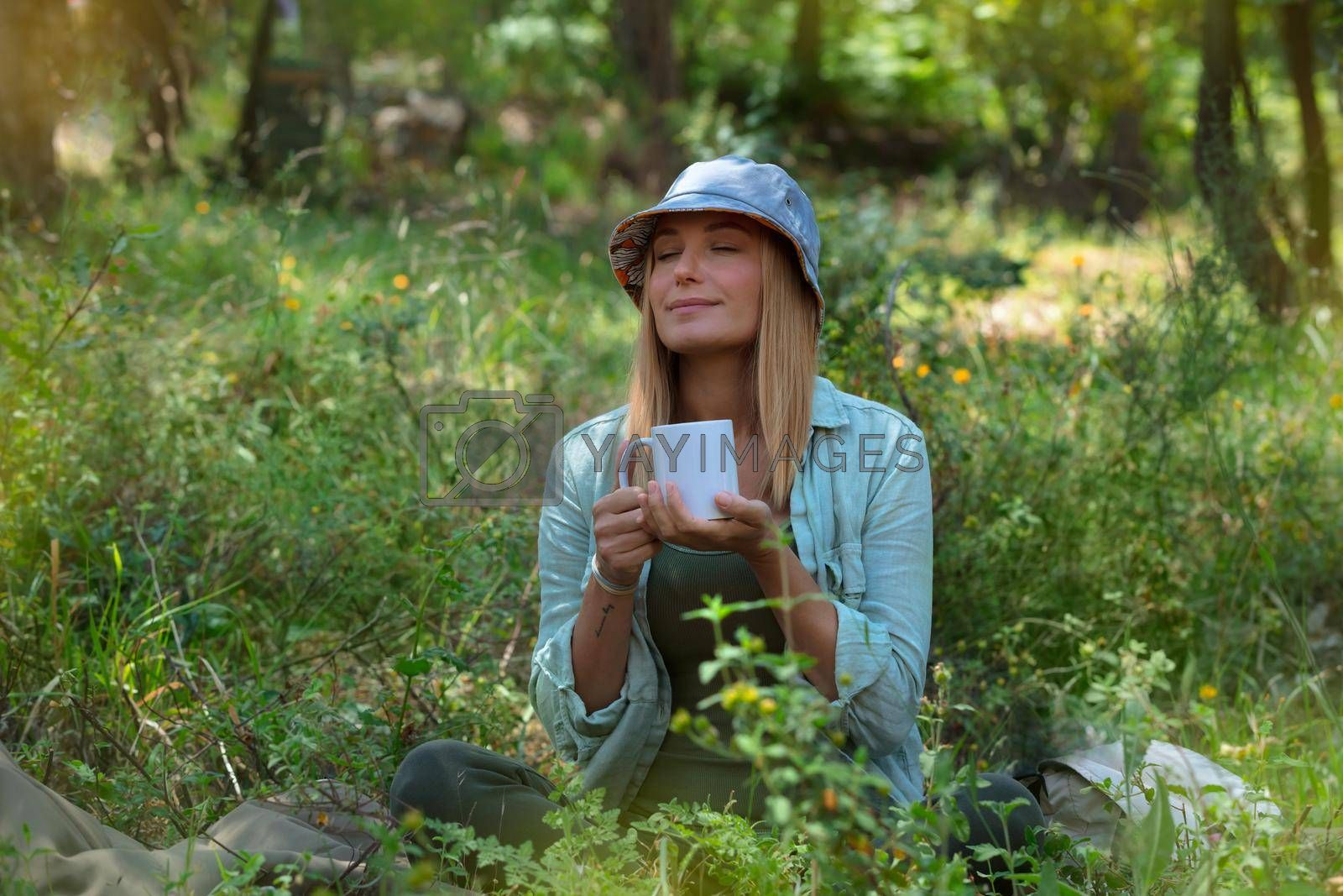 Beautiful Woman Drinking Tea and Chilling in the Forest. Vacation Time. Peaceful Time. Blond Female is Having a Break. Relax the Mind.