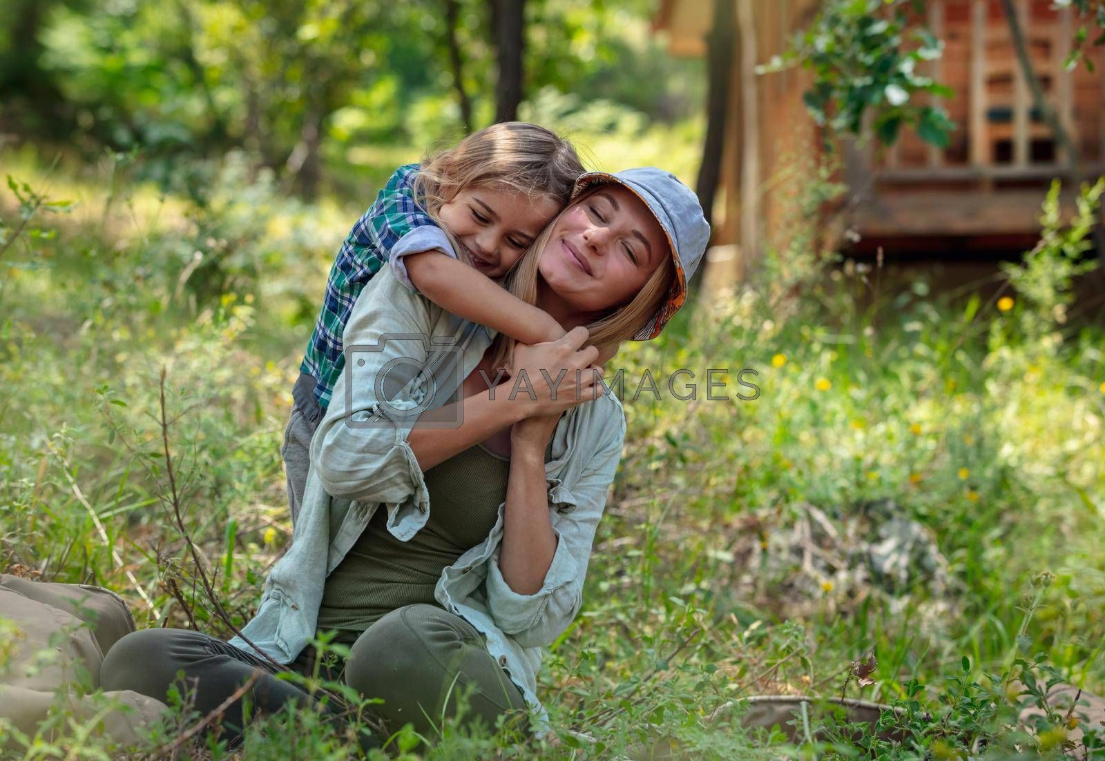 Portrait of a Happy Mother and Cute Little Son in the Forest. Family Having Fun. Summertime Active Vacation. Tight Hugs. Life is Beautiful.