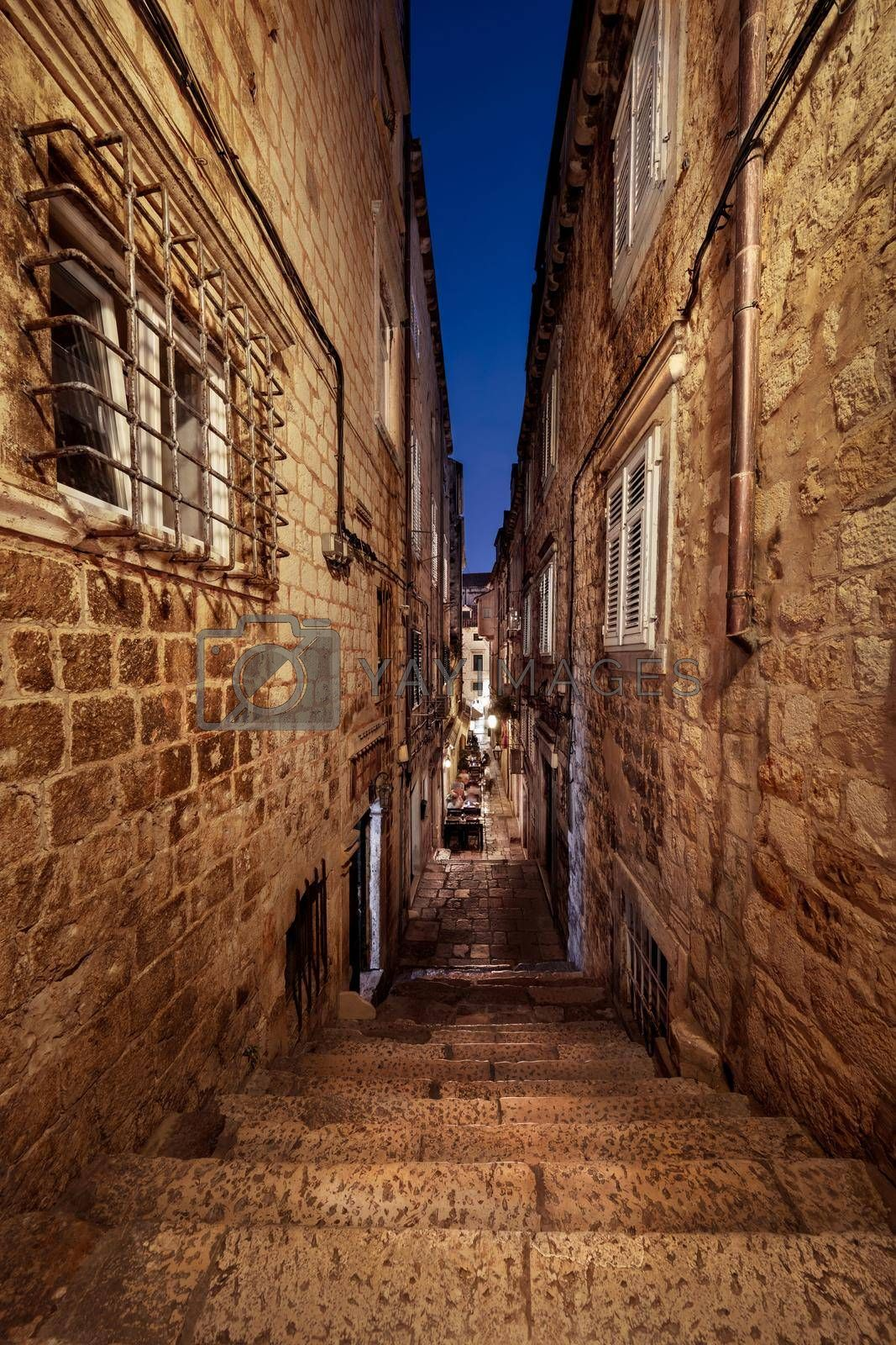 Typical Historical Croatian Street. Venetian Architecture with Stairs Going Down. High Walls Made of Old Bricks. Dubrovnik