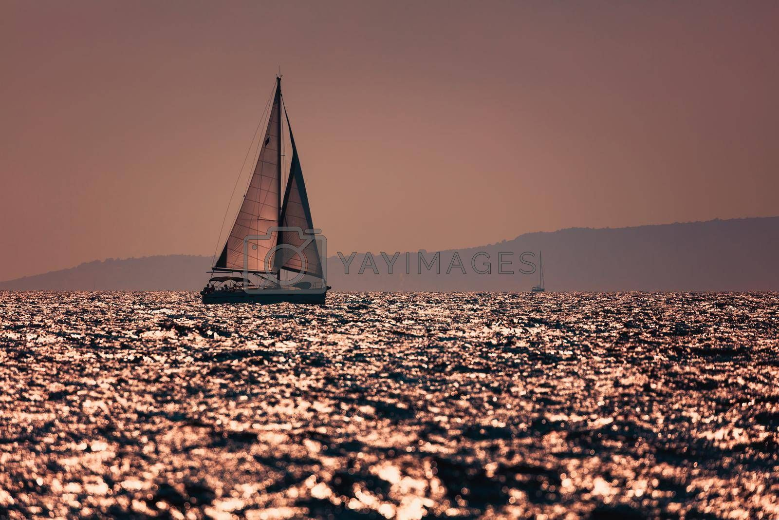 Croatia. Sailboat is Catching the Wind. Sailing on Sunset.