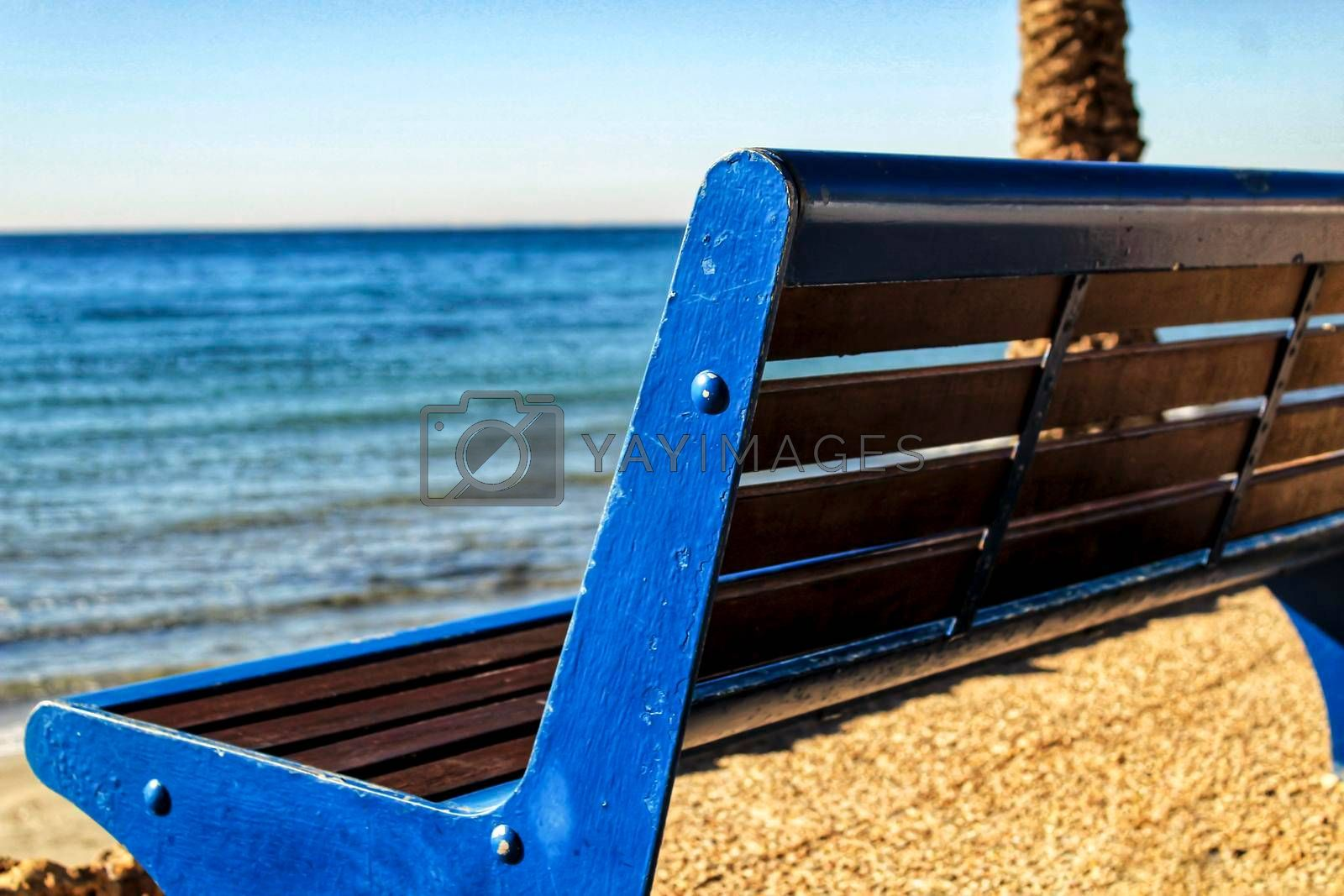 Blue bench with sea view on the beach in southern spain