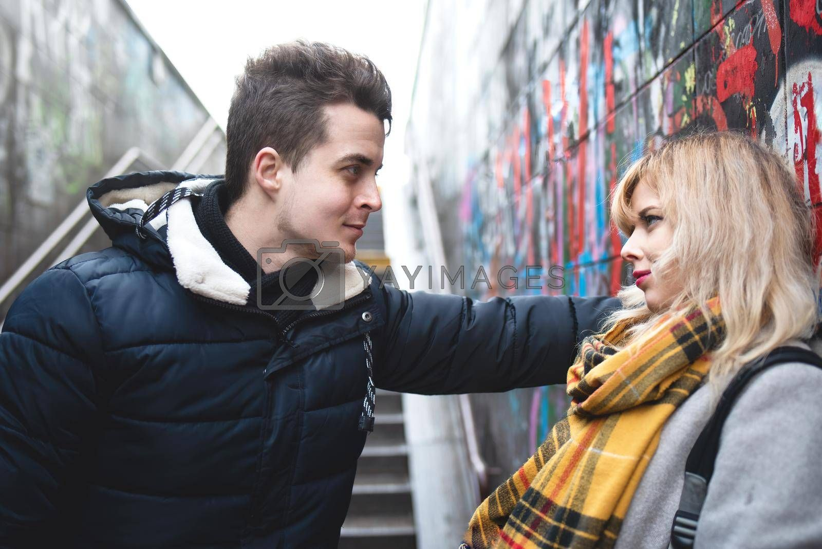 Royalty free image of couple - girl and guy near the wall by Nickstock