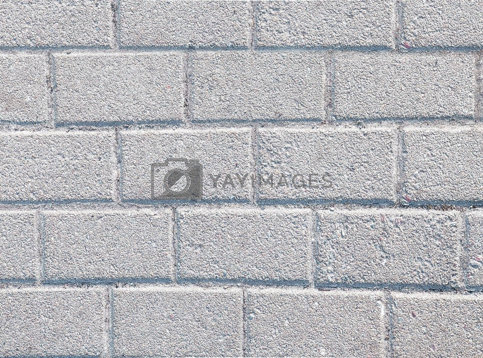 Royalty free image of Abstract background of old cobblestone pavement close-up view by Nickstock