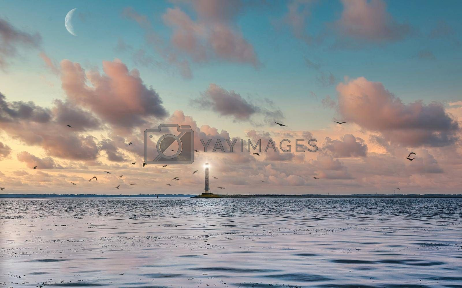 Royalty free image of White Beacon against the calm sea, cloudless evening sky. Seascape of Black sea. by Nickstock