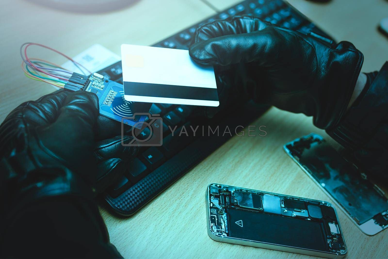 Royalty free image of Hacking concept. Hacker trying to steal mobile payment information. close up view by Nickstock
