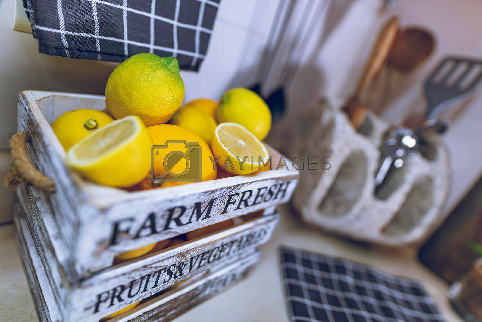 Kitchen Interior. Selective Focus on a Box with Fresh Ripe Lemons. Tasty Citrus Fruits for Lemonade. Home Life. Healthy Organic Nutrition.