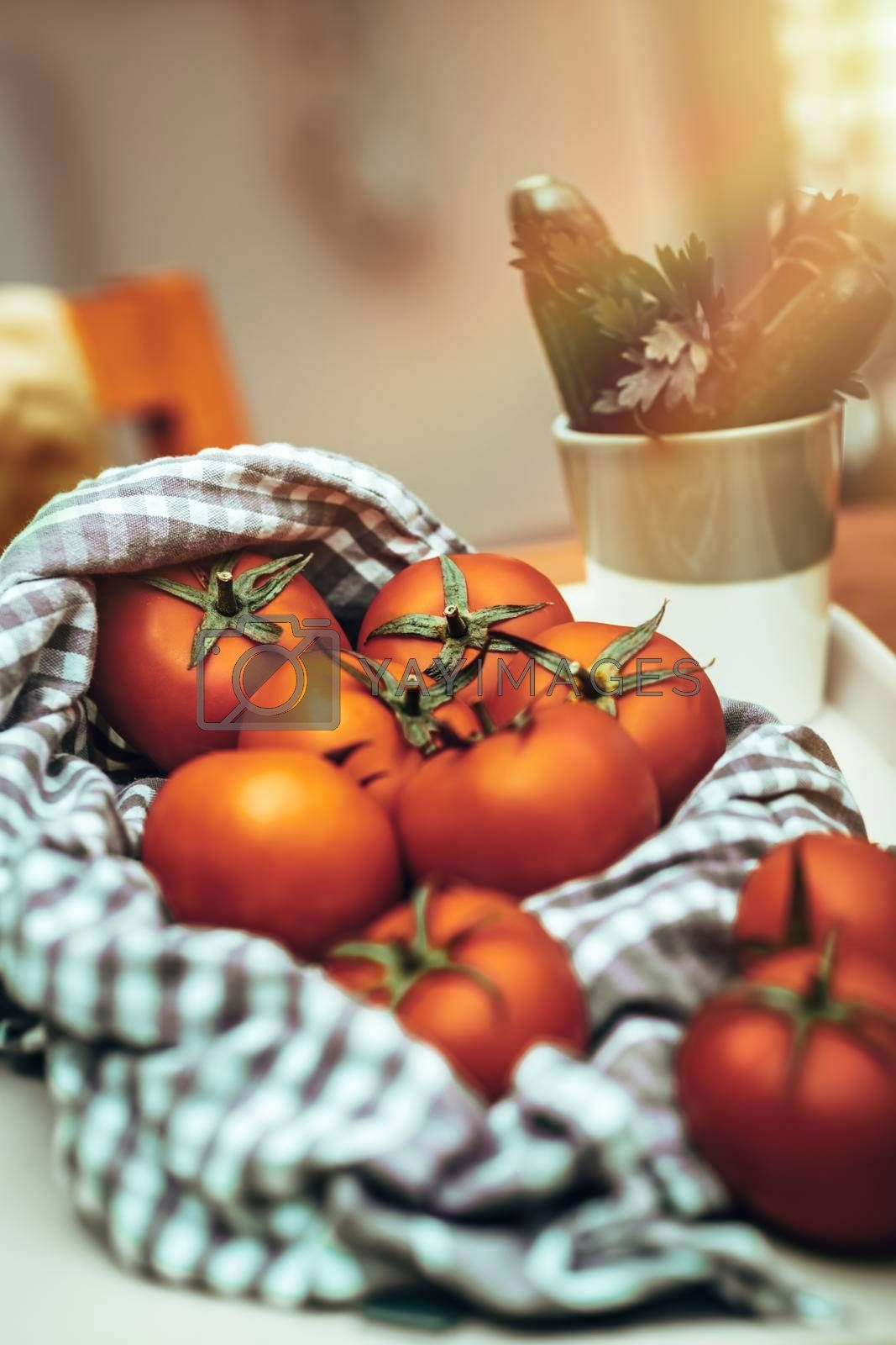 Fresh Red Ripe Tomatoes on the Table in the Kitchen. Ingredient for Salad. Homemade Vegetables. Healthy Organic Nutrition.