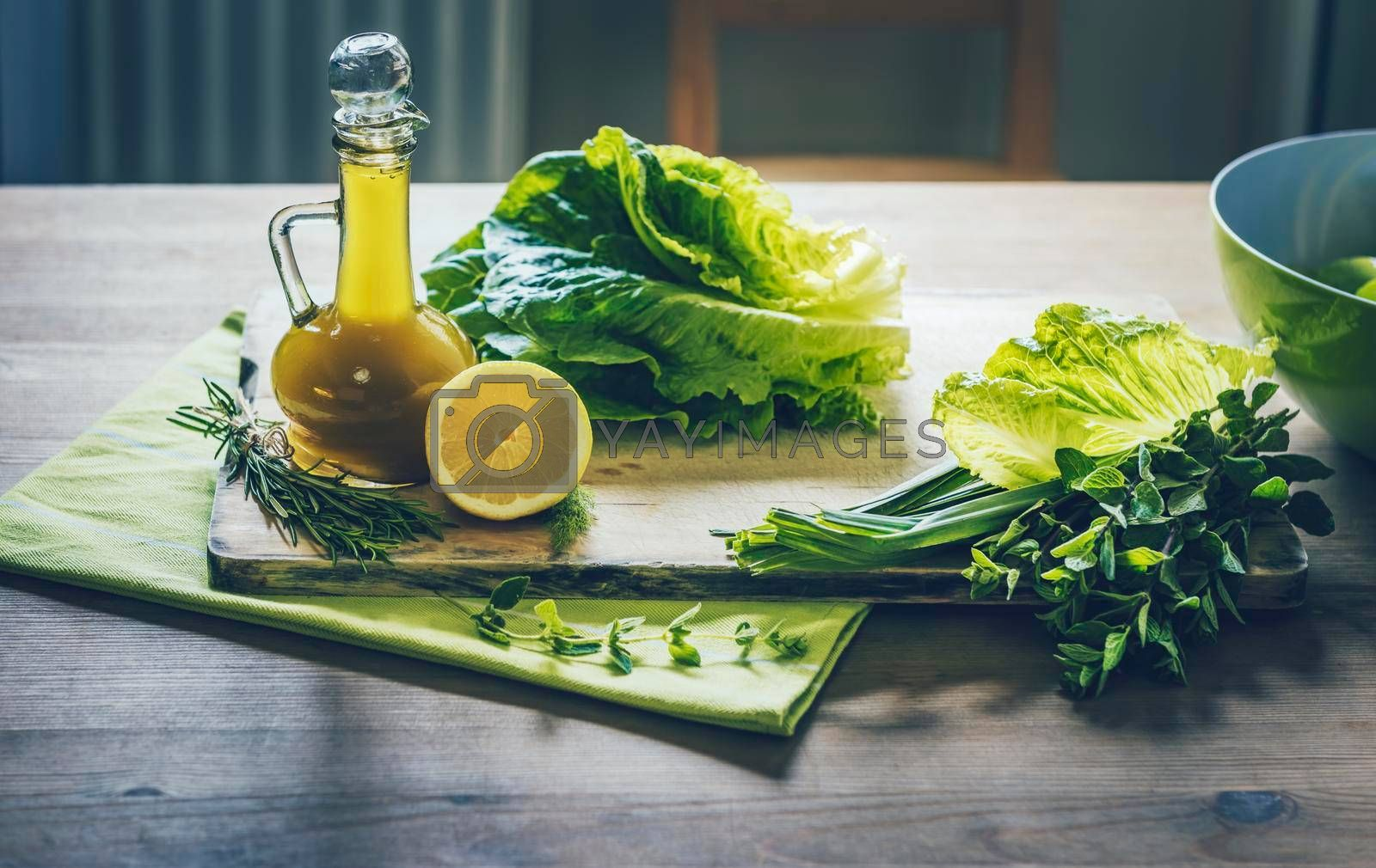 Food Still Life. Tasty Fresh Ingredients for a Green Salad with Olive Oil Dressing. Organic Nutrition. Dieting and Healthy Eating Concept.