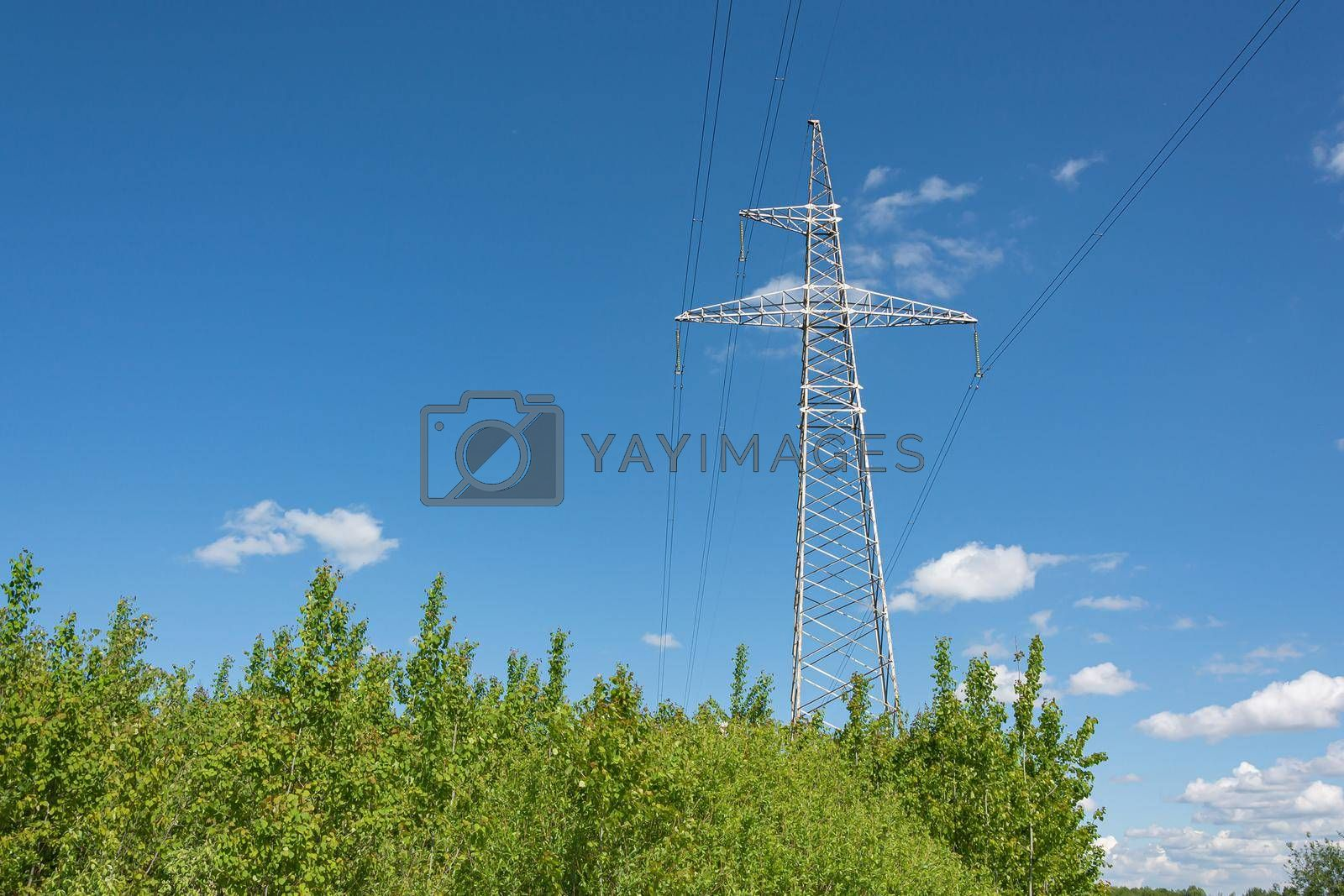 Industry. Support mast and high-voltage power line. Stock photo.