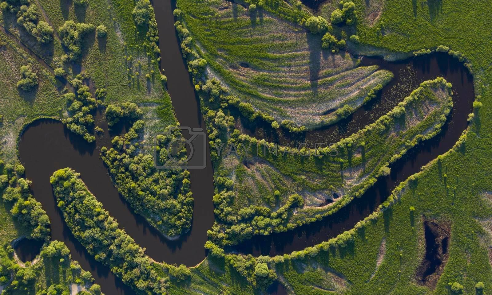 Royalty free image of Aerial view of winding river bed with ducts.  by phortcach