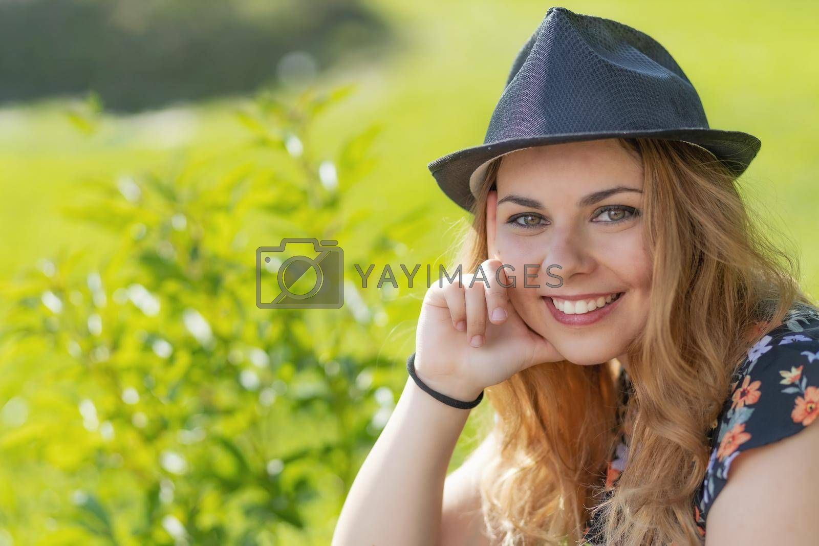 Royalty free image of Portrait of beautiful smiling young woman in sunny day. by Frank11