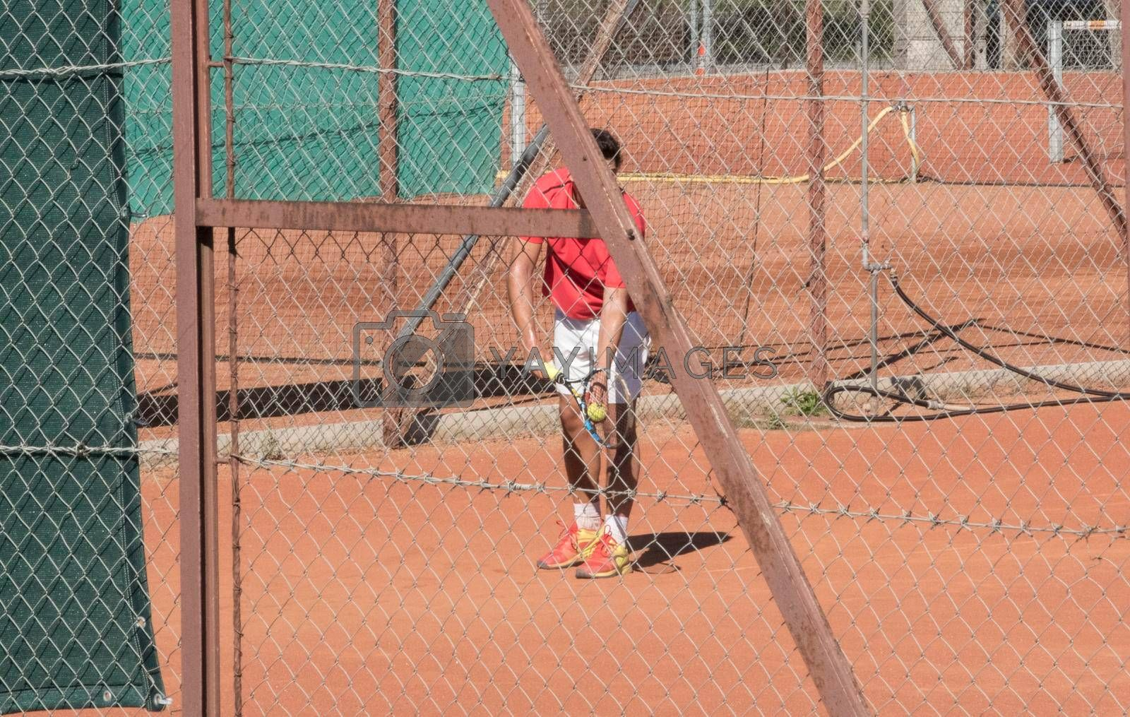 tennis game on a tennis court, game with racket and ball