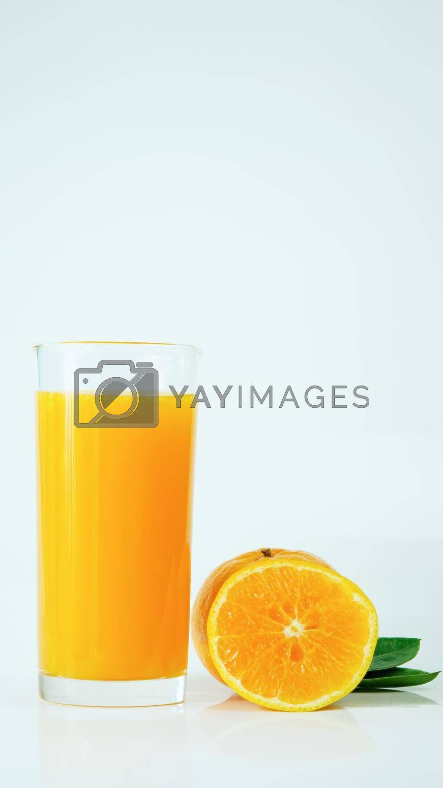 Royalty free image of 100% fresh-squeezed orange juice in a glass And citrus fruit split on white background. Concept of how to live with a naturally refreshing drink that contains vitamin C. by noppha80