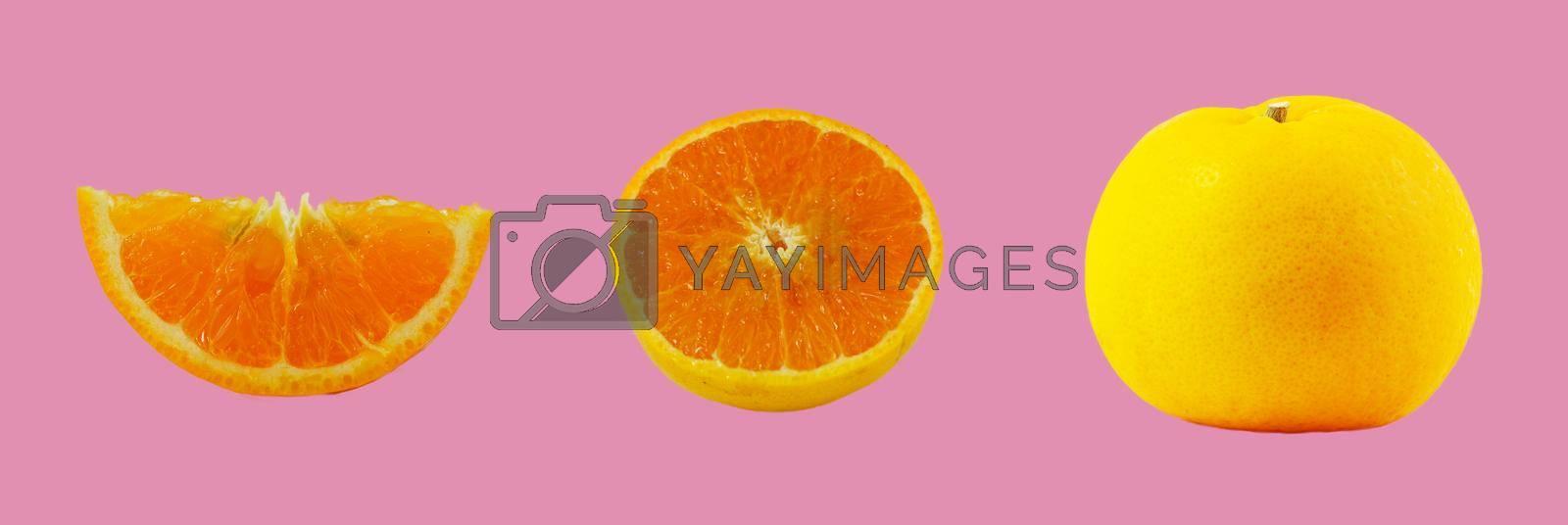 Orange fruit and orange halves Isolated on pink background Natural refreshing fruit concept containing Vitamin C.