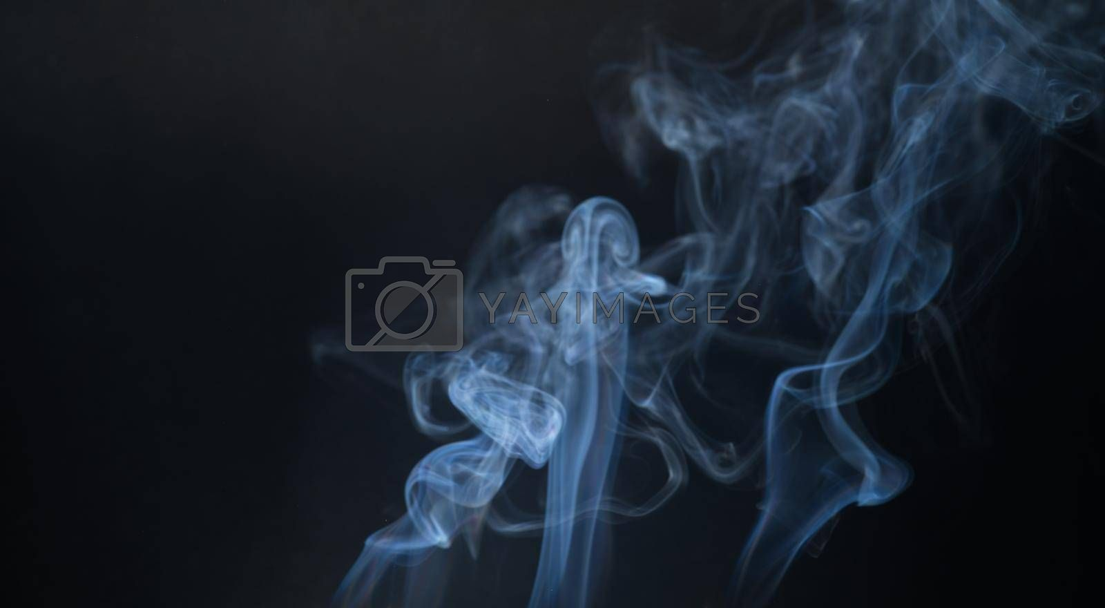 Royalty free image of Vintage smoke color movement on black background with copy space. by noppha80