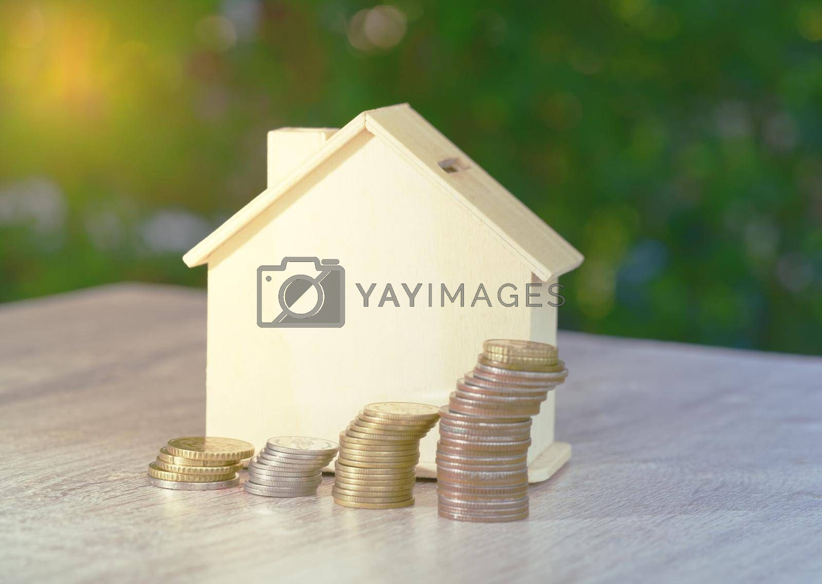 Royalty free image of Abstract stackable coin office desk with model house Real Estate Investment Value Auction Ideas Financial and Economic Investment Wealth. by noppha80
