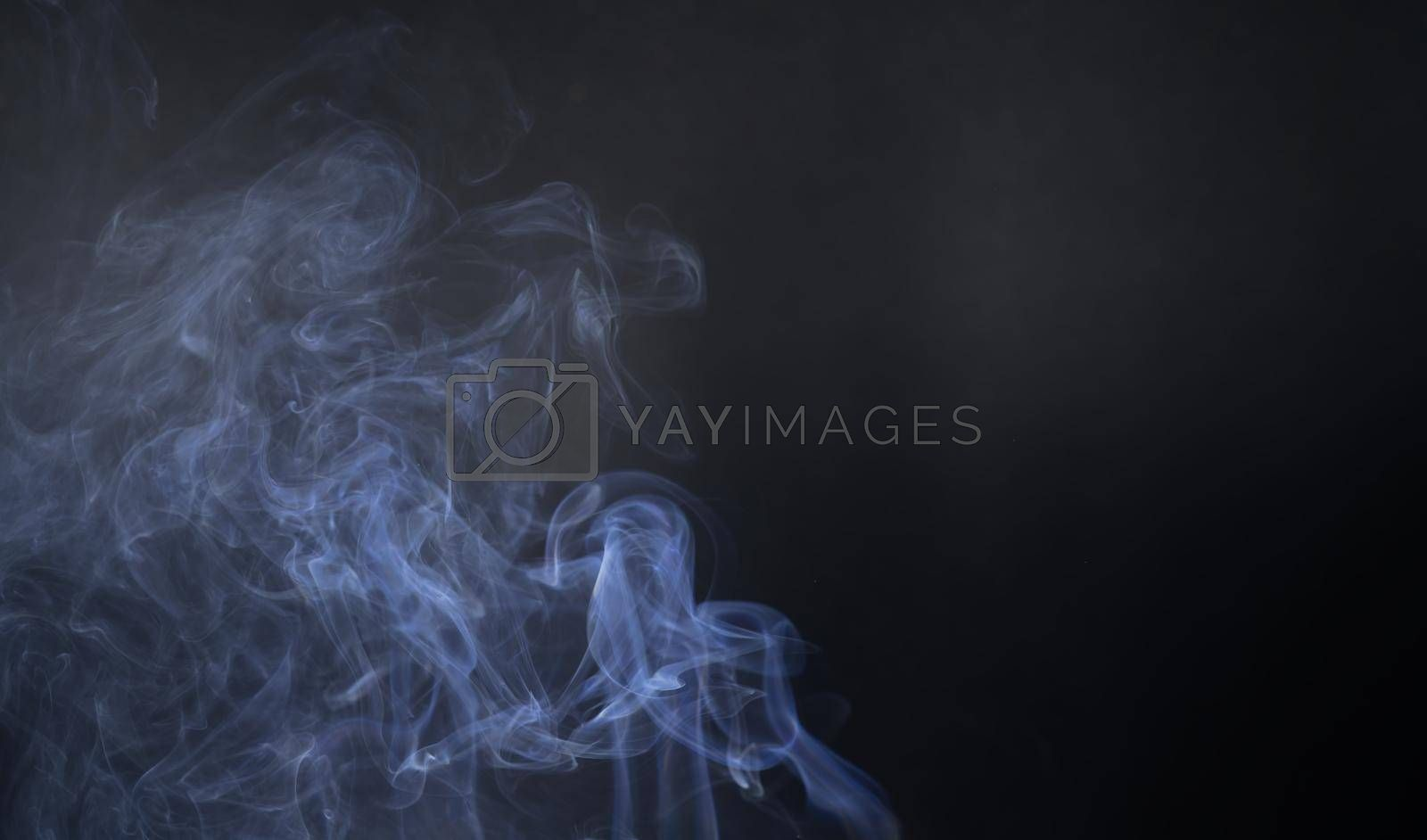 Vintage smoke color movement on black background with copy space.