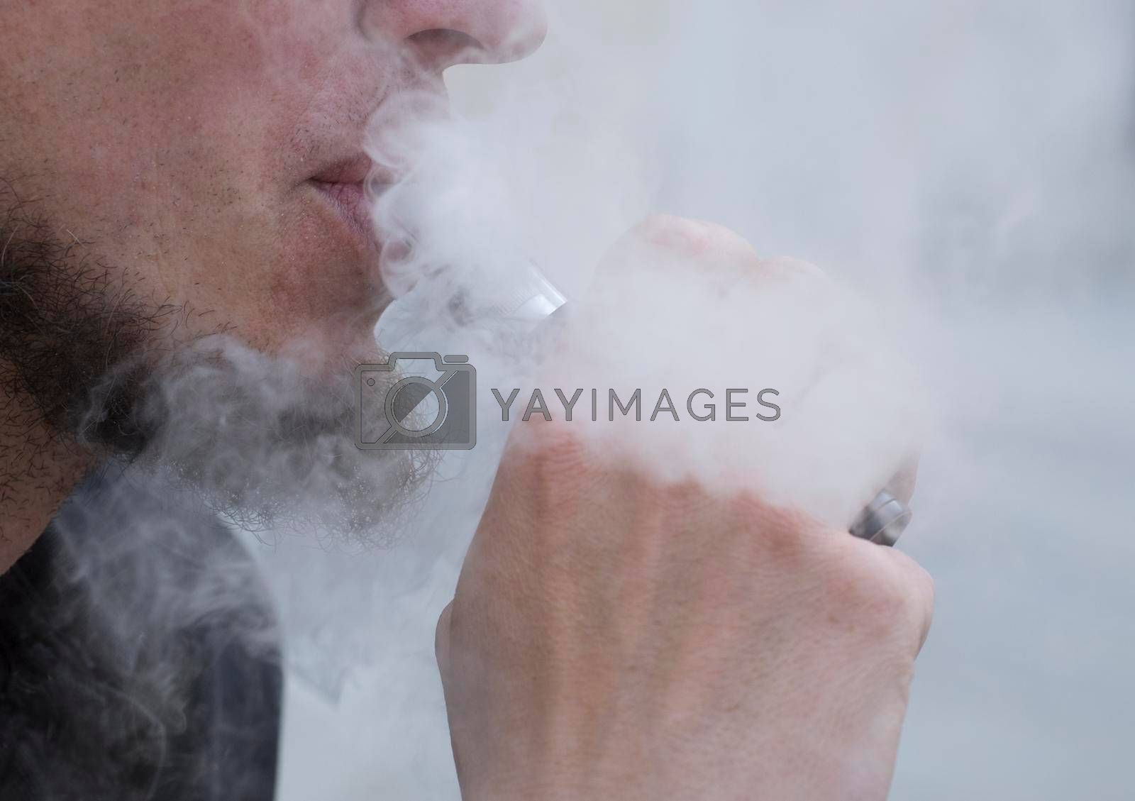 smoking an e-cigarette or electronic cigarette, nicotine consumption and vaping