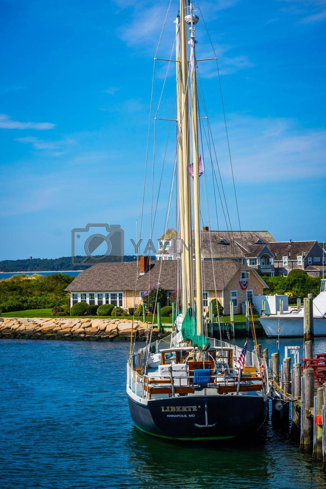 Royalty free image of Cape Cod Marthas Vineyard, MA, USA - Sept 4, 2018: The Liberte Annapolis sailing yacht boat cruising along the shore of Cape Cod by cherialguire