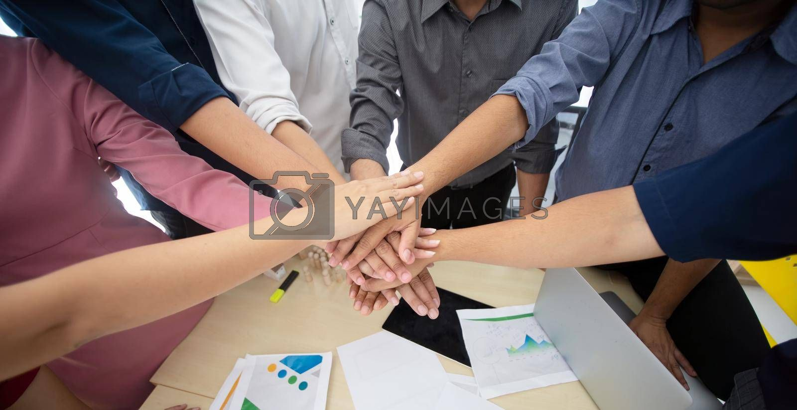Royalty free image of business people hands fist joined together as unity. by chuanchai
