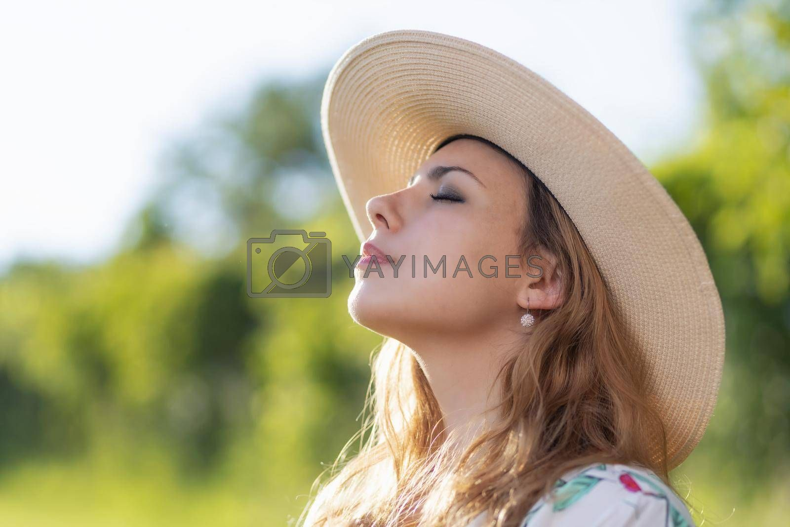 Royalty free image of Side view of sunbathing beautiful young woman. by Frank11