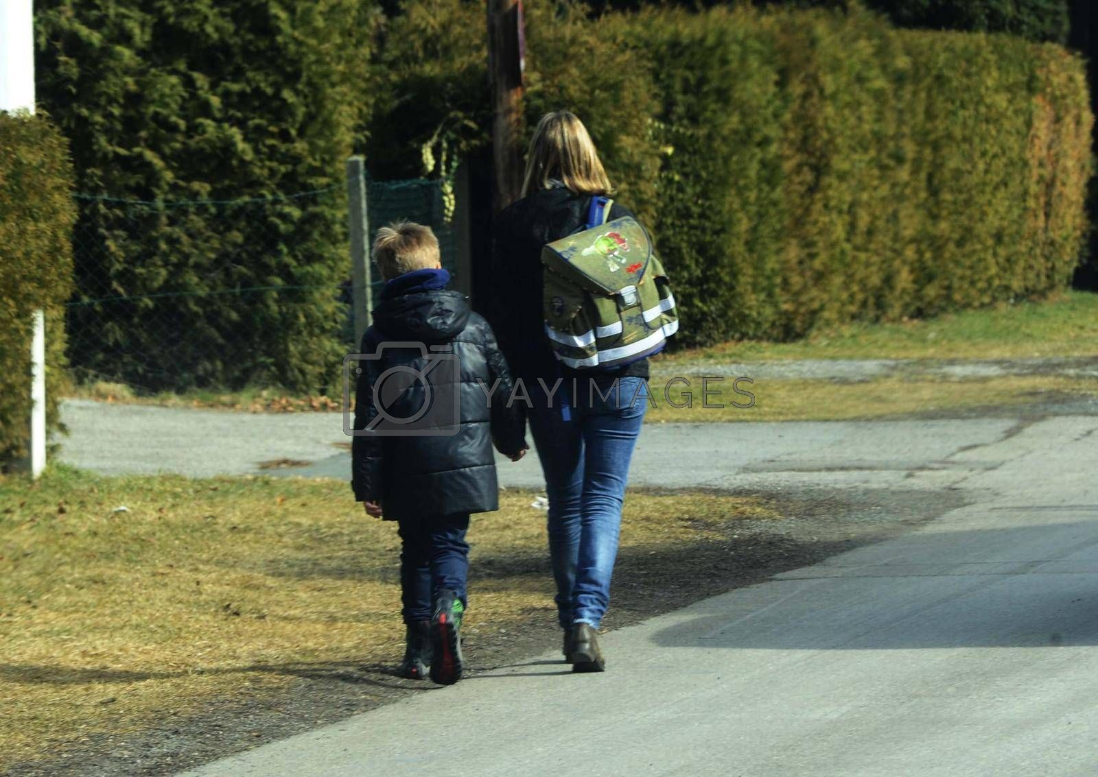 a mother with her child on the way to school
