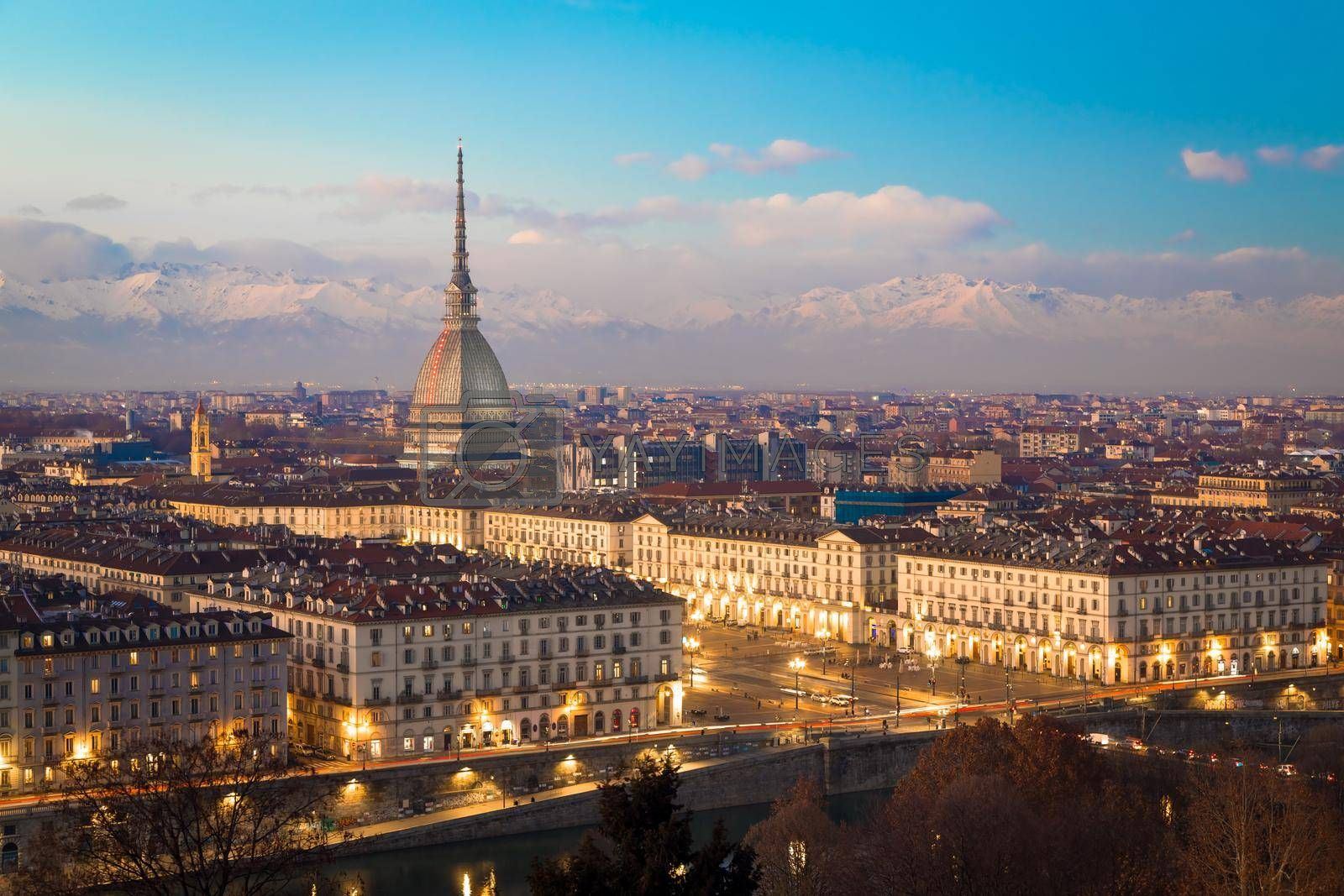 Royalty free image of Turin, Italy. Panorama from Monte dei Cappuccini (Cappuccini's Hill) at sunset with Alps mountains and Mole Antonelliana by Perseomedusa