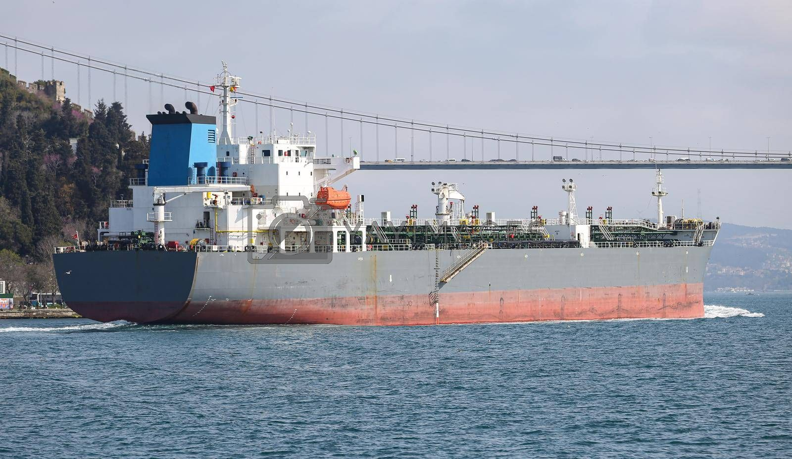 A cargo ship carrying goods between ports